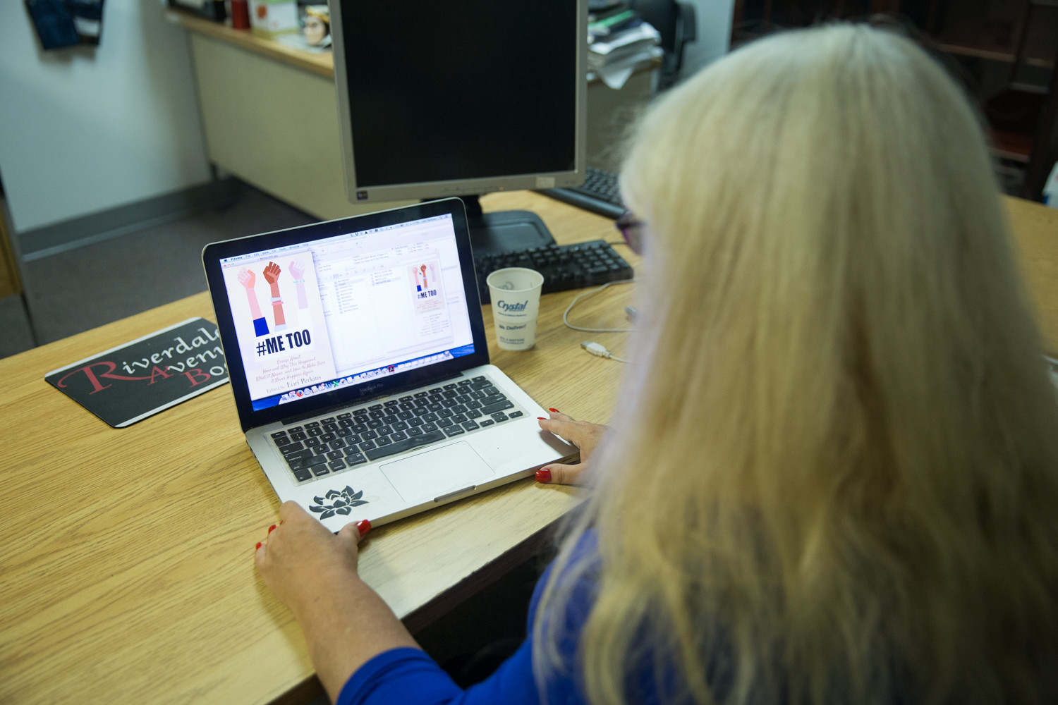 Lori Perkins, the publisher of Riverdale Avenue Books, checks the cover of her e-book of collected essays called 'Me Too: Essays About How and Why This Happened, What it Means, and How to Make Sure it Never Happens Again.' Perkins had the idea for the book in the aftermath of the Harvey Weinstein sexual harassment controversy.