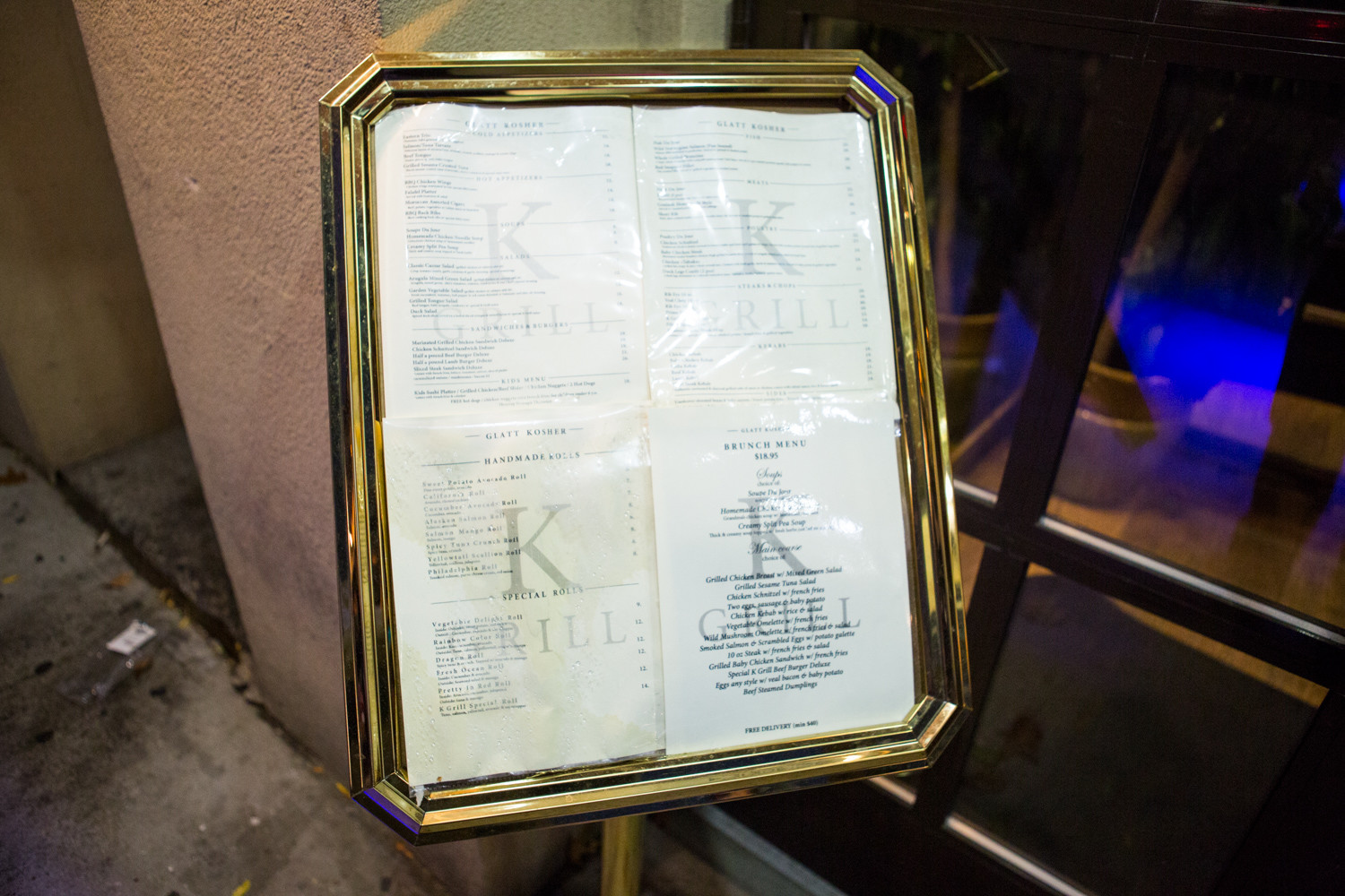 A menu outside of Riverdale K Grill House features a wide array of kosher dishes, with an emphasis on steak, as well as grilled fish and finely seasoned kebabs. K Grill's owner, Dmitriy Berezovskiy, wanted to offer the community a kosher fine-dining concept, but the local rabbinical supervision imposed severe restrictions on which foods he was allowed to serve, making it difficult for him to compete with other neighborhood restaurants.