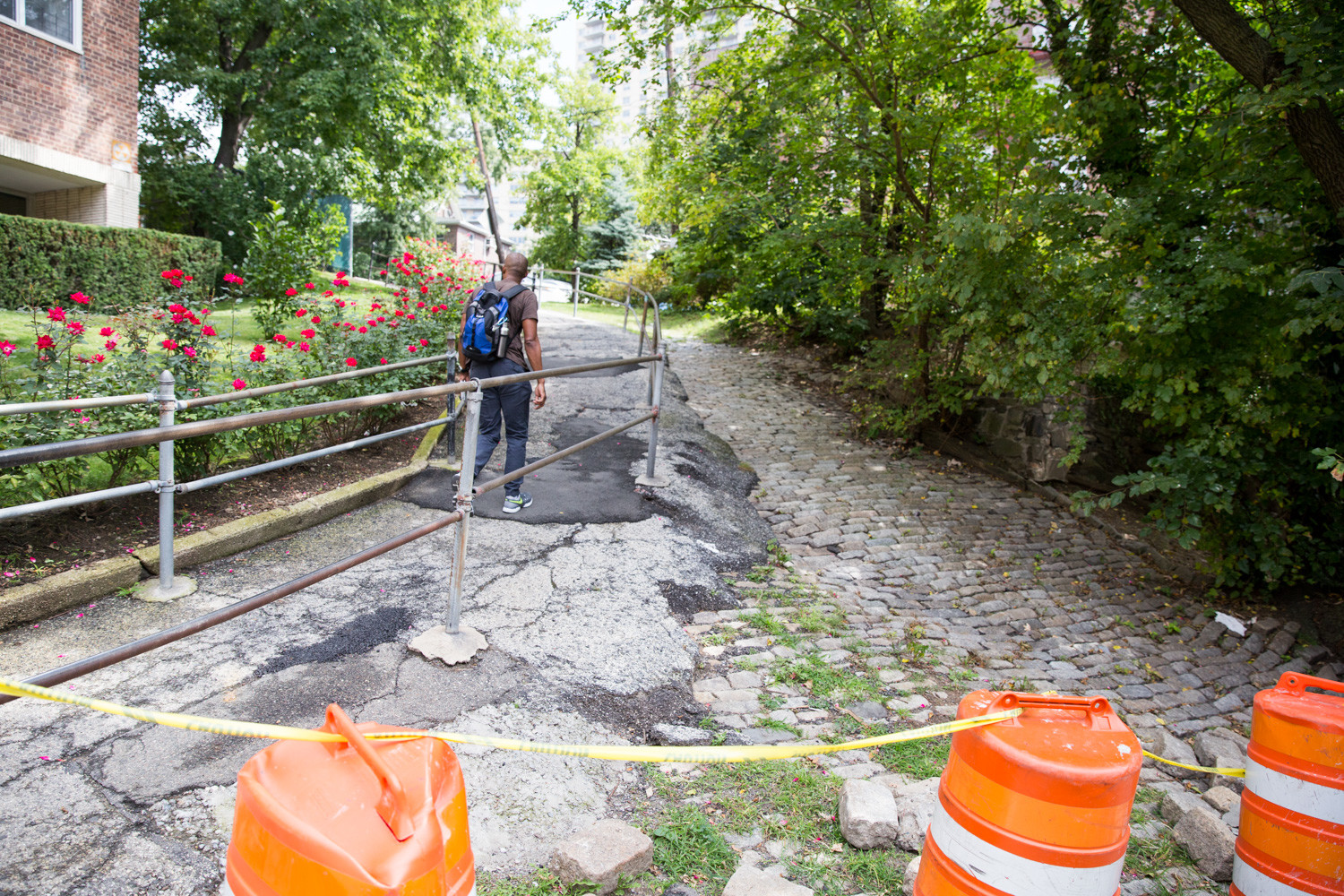 A pedestrian walks up the path between Kappock Street and Arlington Avenue. Local elected officials have renewed a two decades-old request to the city's transportation department to repair both the path itself and the railings.