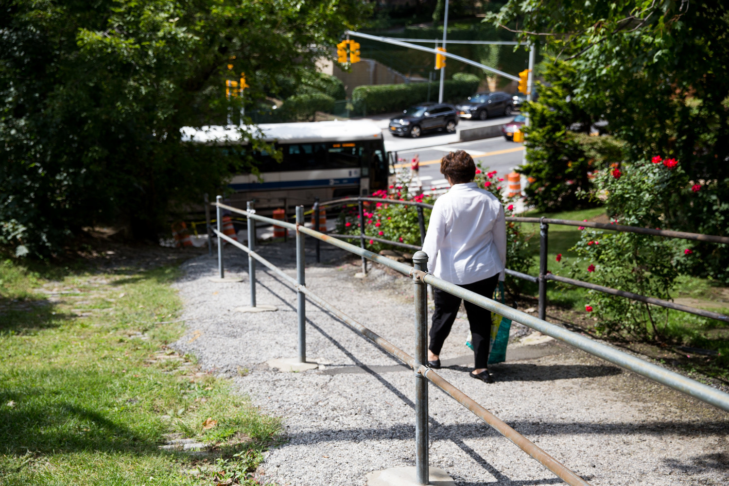 A pedestrian walks down the path between Kappock Street and Arlington Avenue. Local elected officials have renewed a two decades-old request to the city's transportation department to repair both the path itself and the railings.