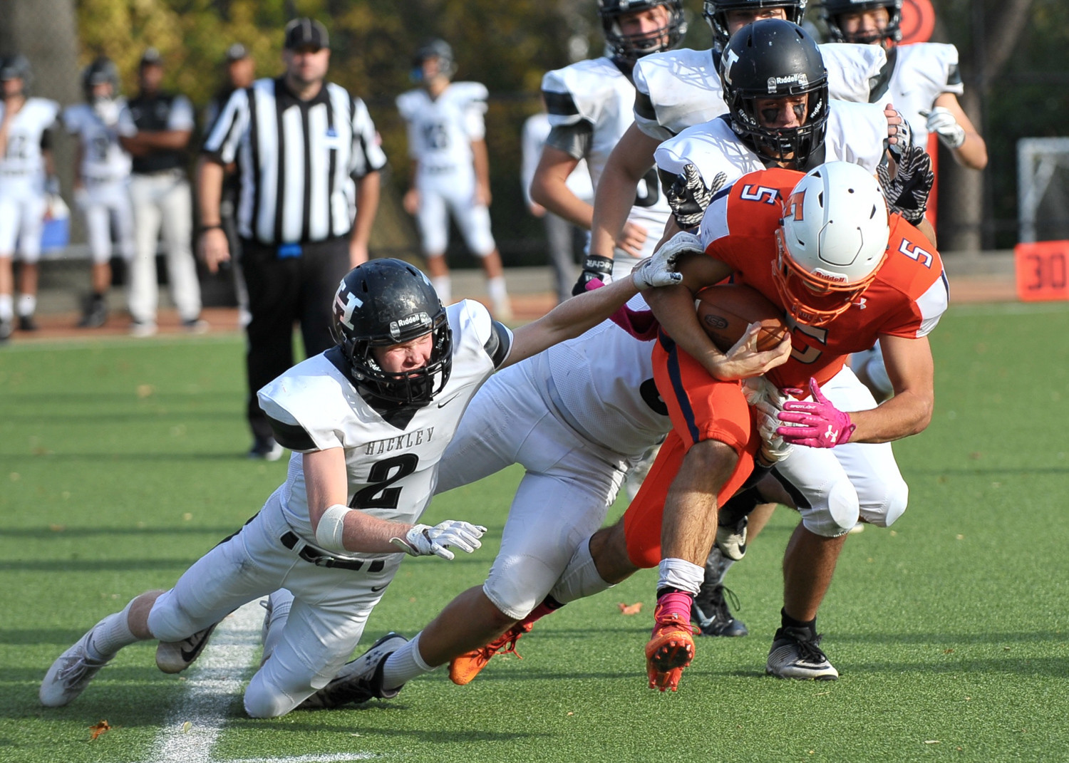 Fieldston's Alexander Thorpe takes two defenders along for the ride during a run in last Saturday's division championship game against Hackley.