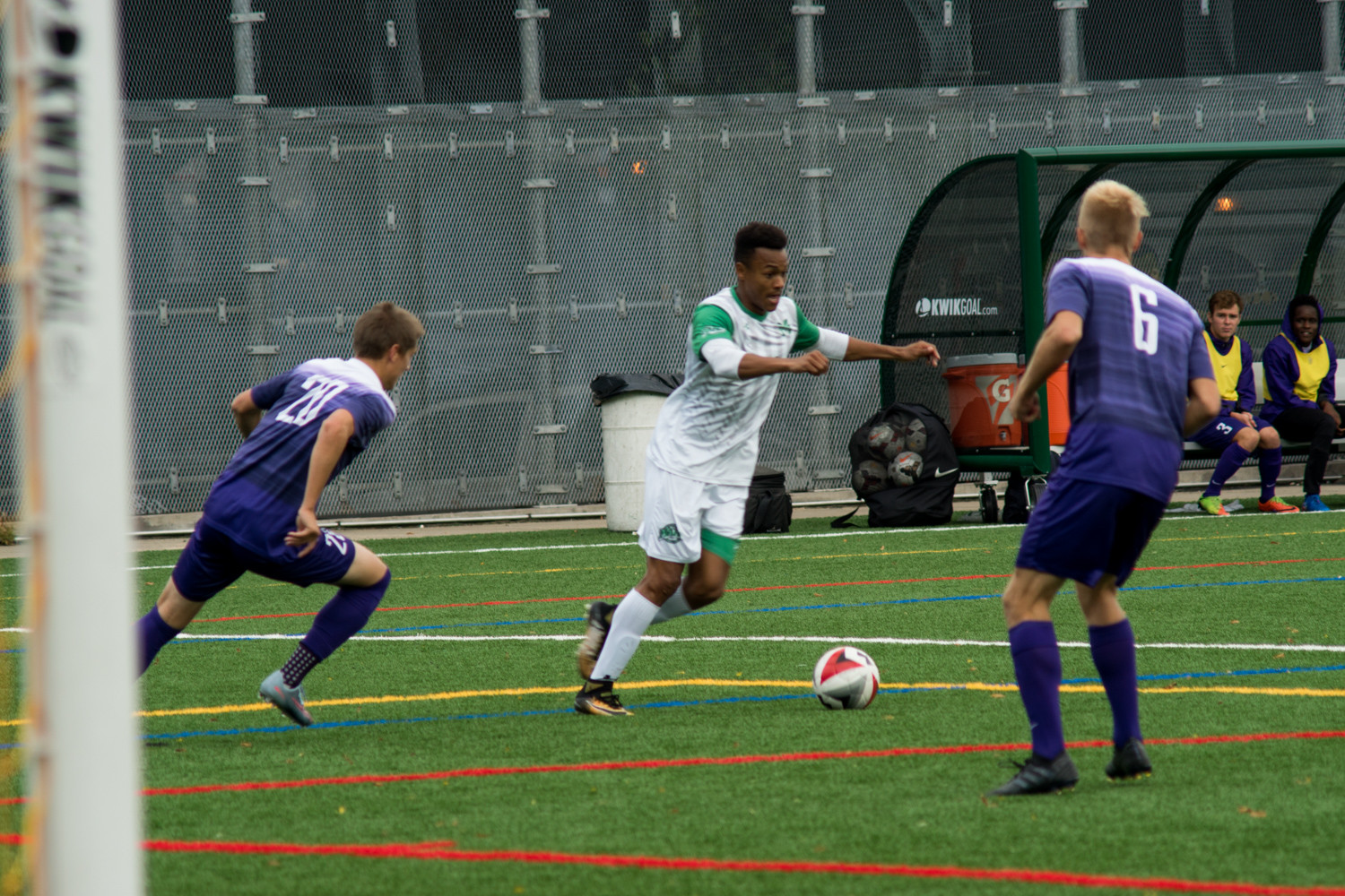 Manhattan's Troy Carrington looks to split a couple of Niagara defenders in the Jaspers' 1-0 victory last week.