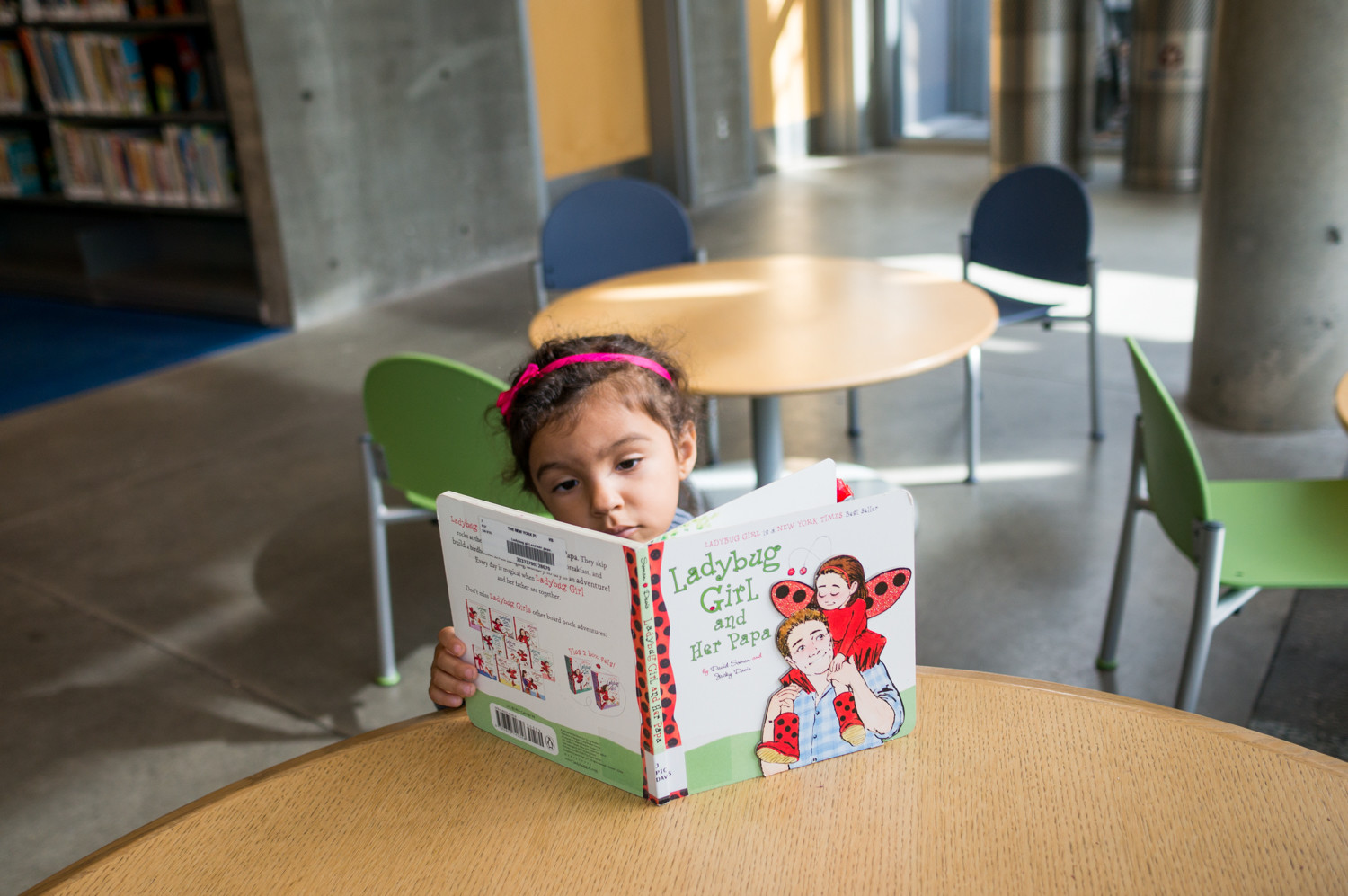 The one-time fine forgiveness at city libraries has allowed young cardholders like Camila Figueroa, 2, to check out materials like the current book she's reading 'Ladybug Girl and Her Papa.' Her mother, Janneth Mejia-Figueroa, brings her Camila, along with her sister and brother Nataly and Ethan to the library.