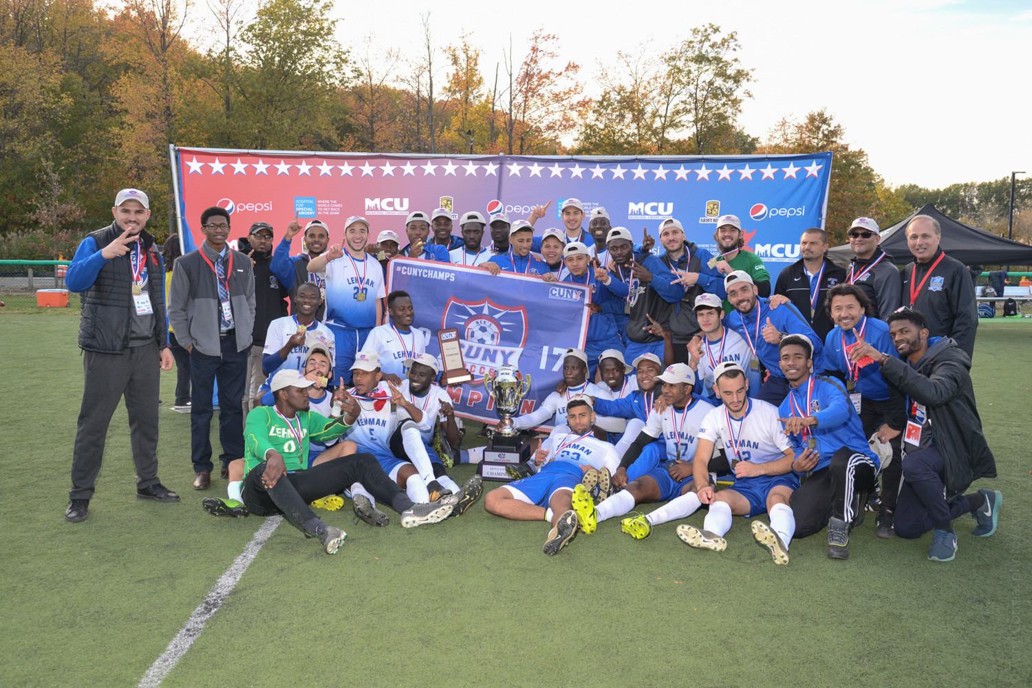 The Lehman men's soccer team celebrates its second consecutive CUNYAC title after its 3-1 victory over John Jay.