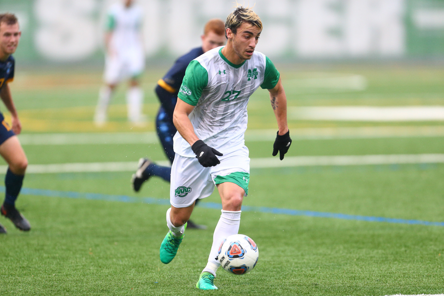 Manhattan's Lucas Da Silva creates a path upfield during the Jaspers' MAAC tournament quarterfinal game versus Quinnipiac at Gaelic Park.