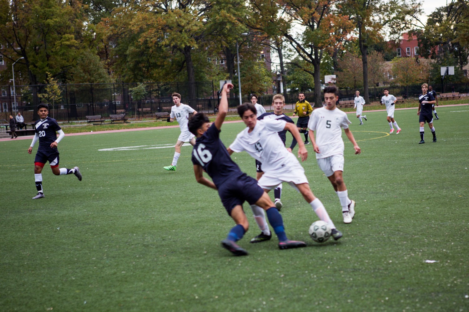 Bronx Science's Mikael Young Malka (43) tries to get around Fort Hamilton defender Jonathan Granados during the Wolverines' 2-0 playoff loss last week.