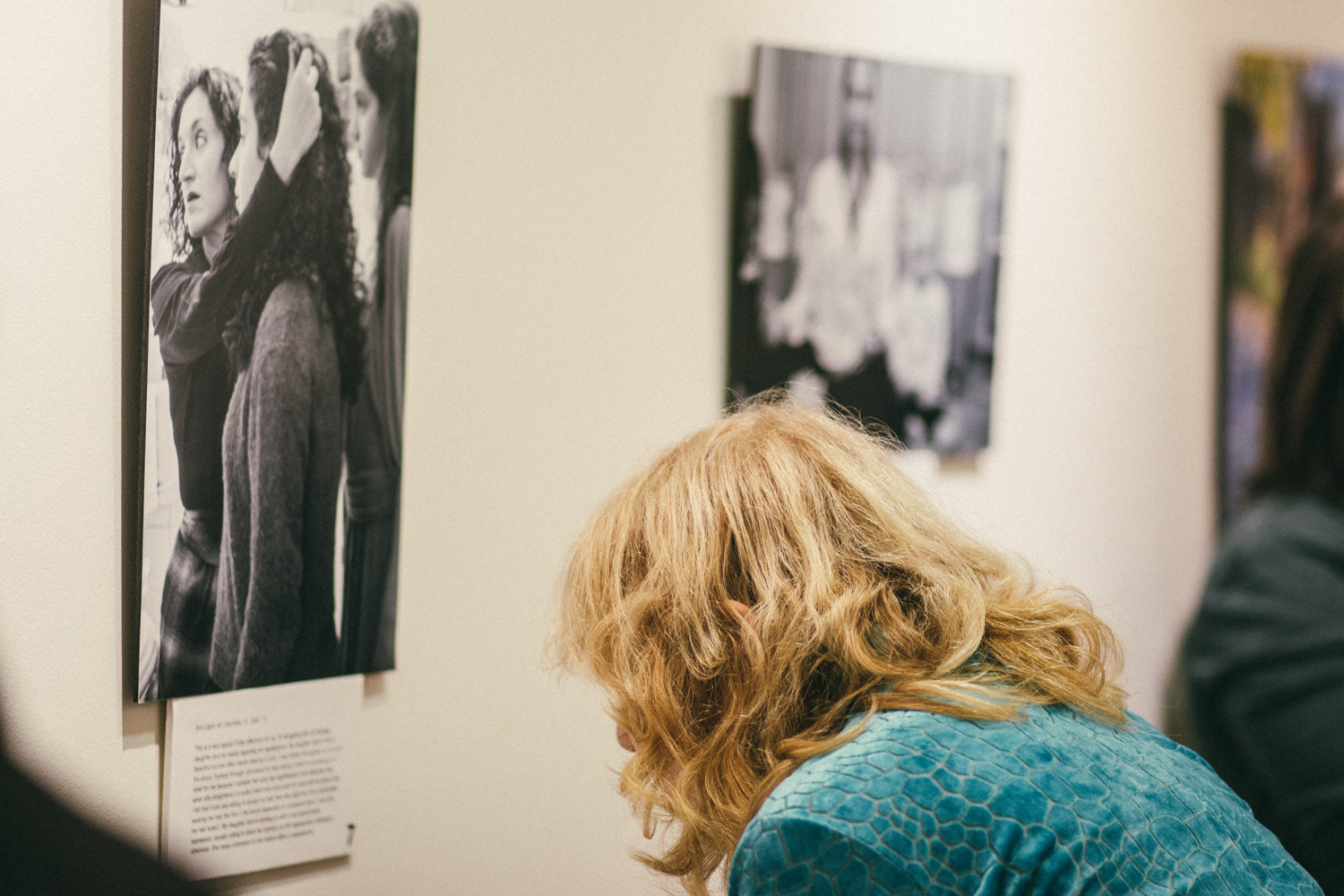 A visitor reads the caption beneath one of the gallery's photos. Photographer Aviva Braun's exhibit, 'The Embodyment of Jewish Femininity,' is on display at The Riverdale Y's Gallery 18 throughout November.