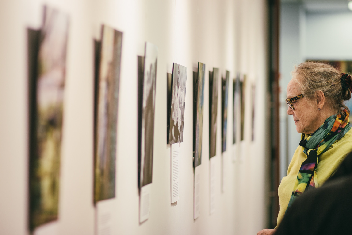 A visitor looks at the photographs in Aviva Braun's exhibition 'The Embodyment of Jewish Femininity' at The Riverdale Y.