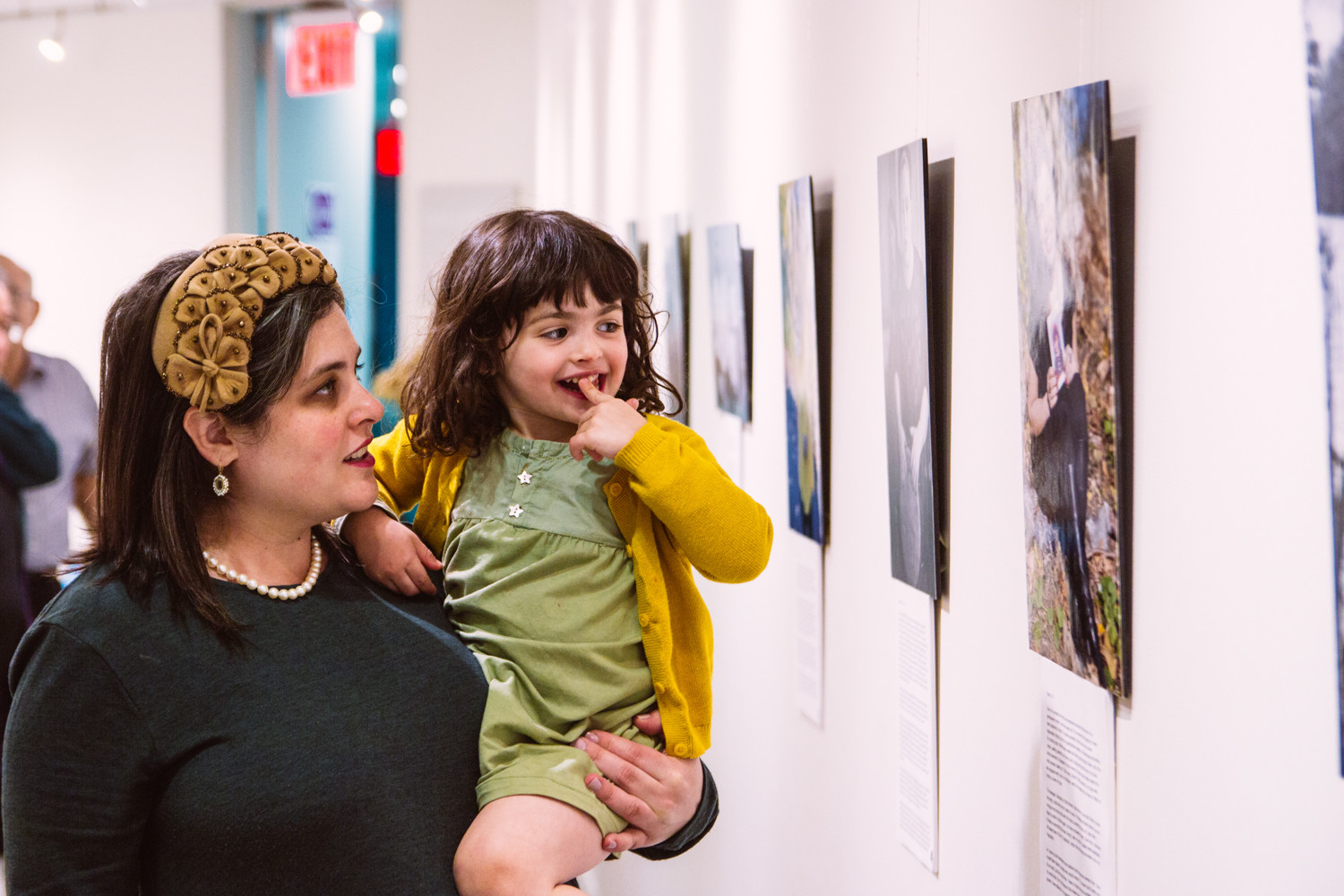 Aviva Braun and her daughter look at images in her exhibition 'The Embodyment of Jewish Femininity' at The Riverdale Y.