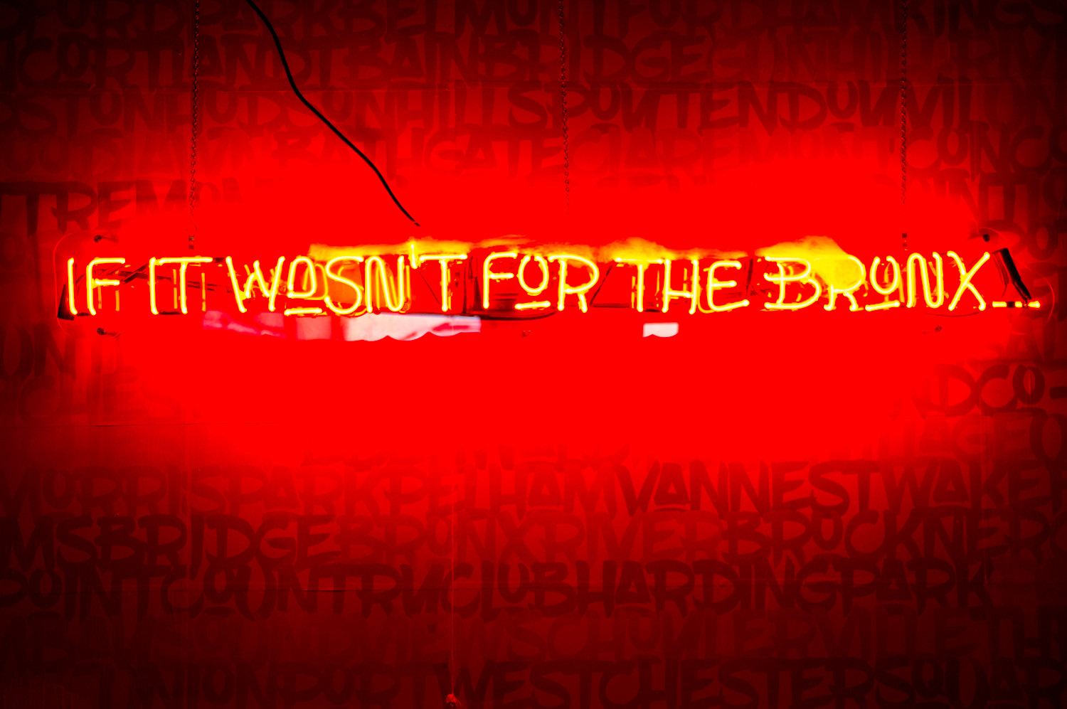 The Bronx Public has a variety of art on the wall, including a neon sign that reads 'If it wasn't for the Bronx,' which celebrates Bronx culture.