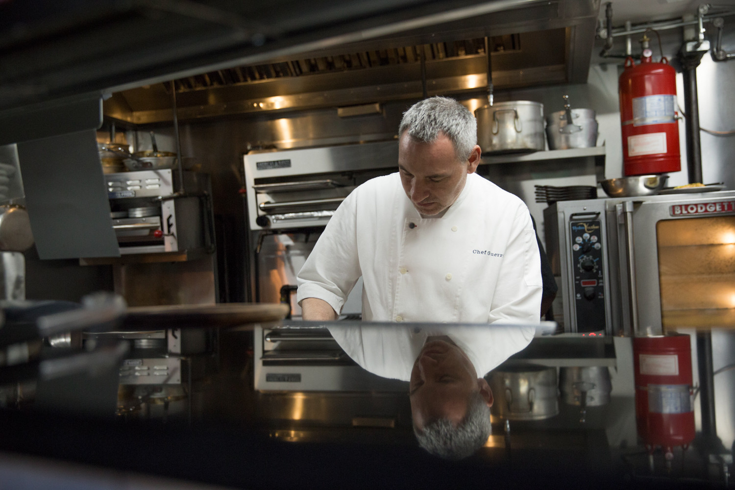 The Hill Bistro's chef Michael Guerrieri preps for the evening's opening in the kitchen. The restaurant opened Sept. 22 and brings live music and brunch to Riverdale Avenue.