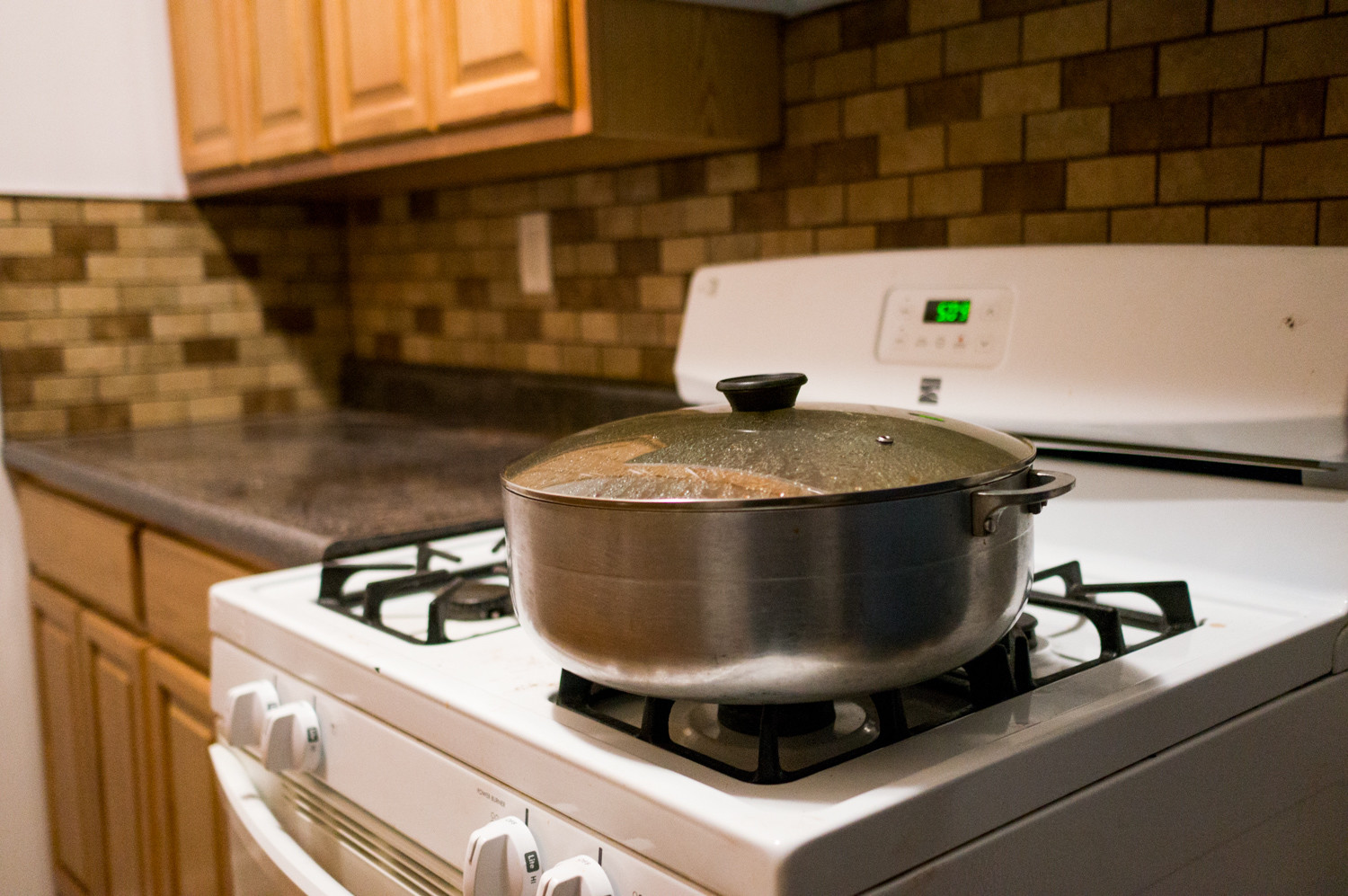 A pot of food rests on a stove in the newly renovated kitchen of an apartment at 3115 Sedgwick Avenue.
