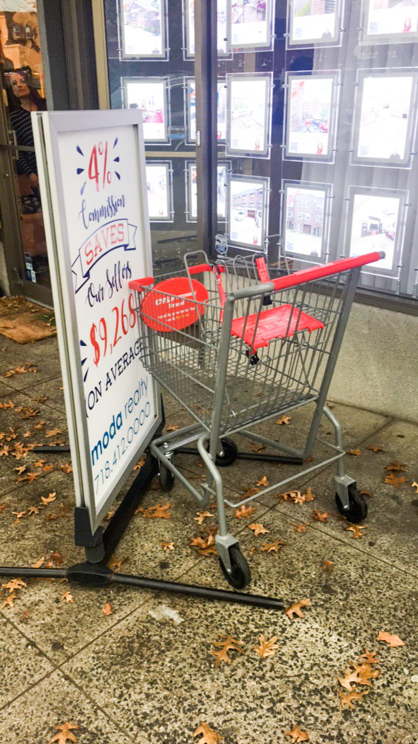 For weeks, managers at Moda Realty believe students have vandalized a sign posted outside the Riverdale Avenue business. One afternoon, they allegedly shoved a shopping cart from a nearby pharmacy into it.