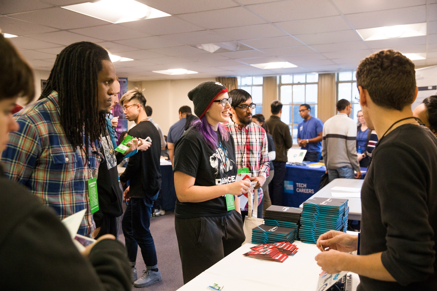 Students taking part in the Lehman College Hack-athon network with sponsors. The goal of the 18-hour event is to give students from underrepresented and diverse backgrounds the chance to showcase their talents, and newcomers an opportunity to learn new skills. This is the fourth year Lehman has hosted the event.