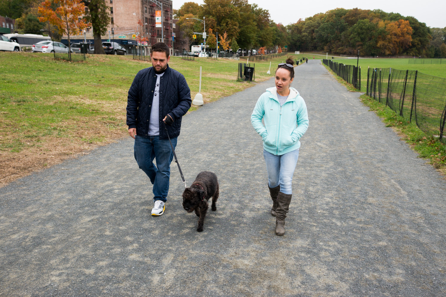 Chad Goldman and Leslie Centofanti walk their dog Lula in Van Cortlandt Park. Goldman and Centofanti run Pumkin Paws, a dog walking service that will open a brick-and-mortar location in Riverdale.