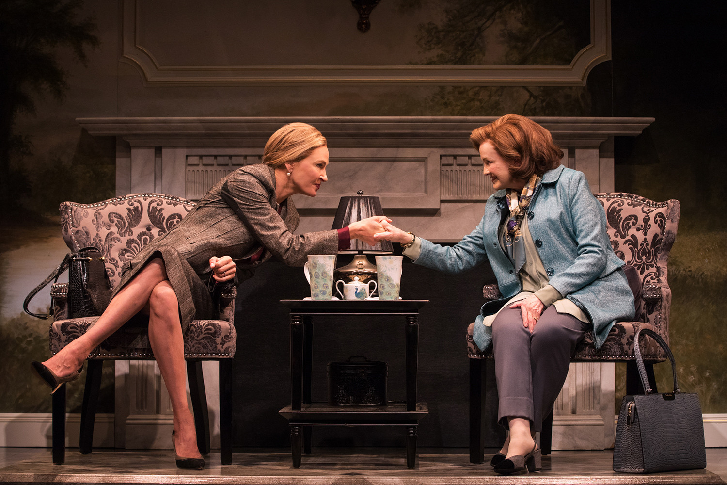 Uma Thurman, left, makes her Broadway debut in the limited engagement play 'The Parisian Woman' from 'House of Cards' creator Beau Willimon. Joining her in a handshake is Blair Brown.