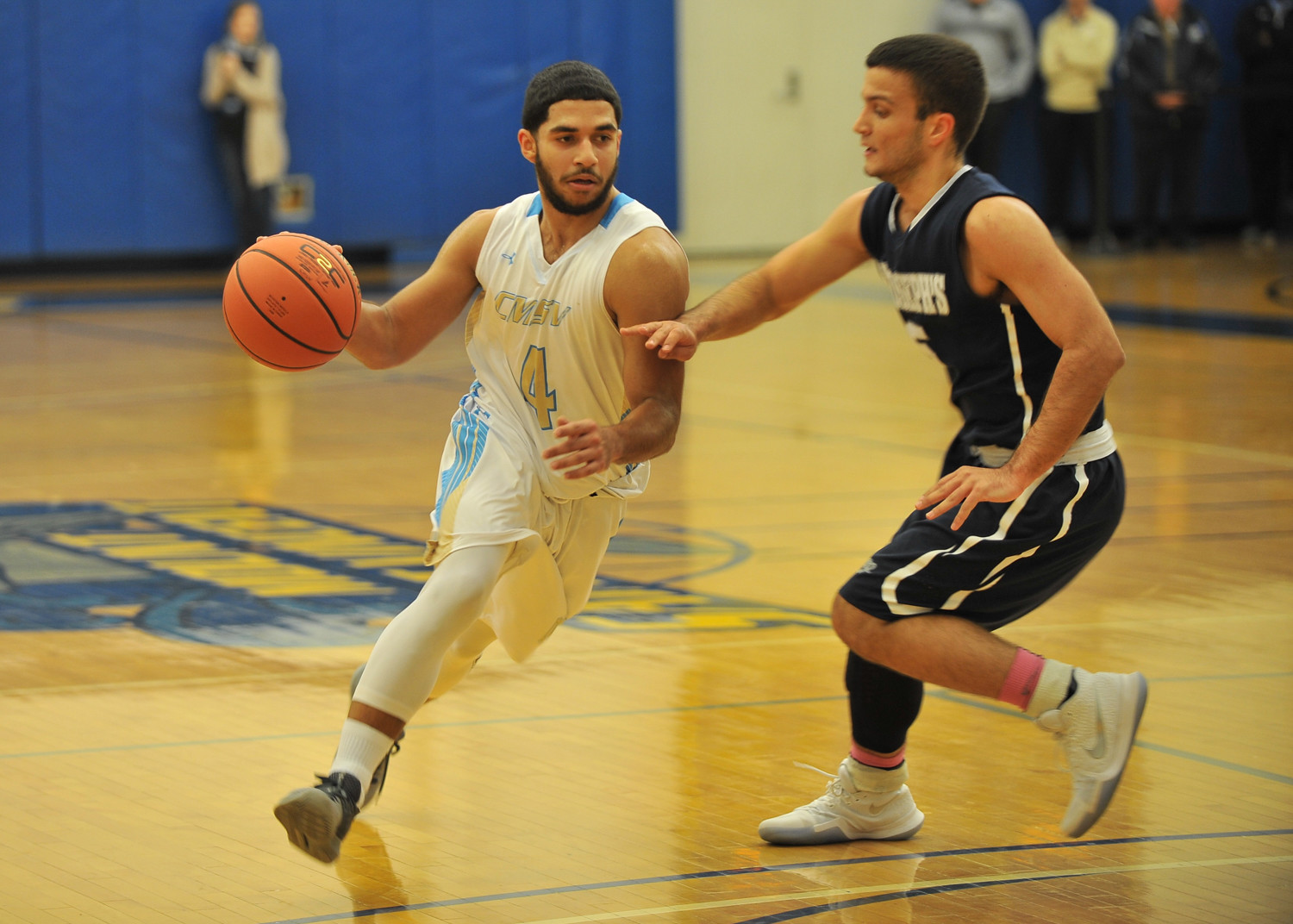 Mount Saint Vincent senior guard Jose Maestre, who had nine points versus Saint Joseph's, looks to work around a Bears' defender.