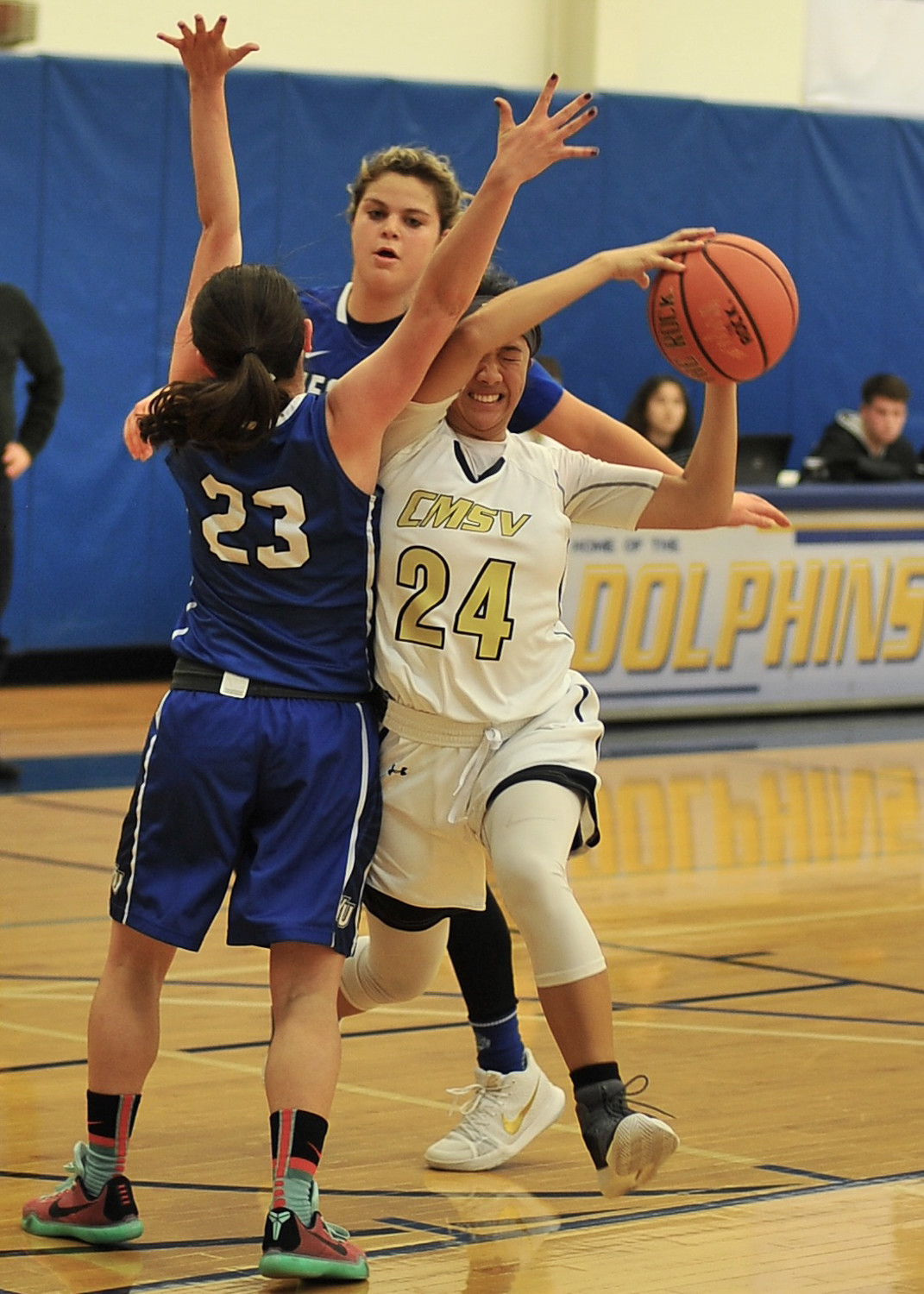 Mount Saint Vincent point guard Leah Pinili runs into some trouble with a pair of Yeshiva defenders in the Dolphins' Skyline Conference victory last week.