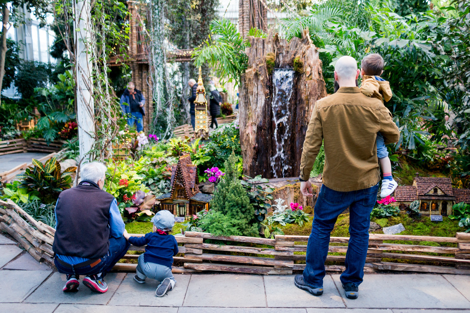 families take in the holiday train show at the new york botanical garden - Bronx Botanical Garden Train Show