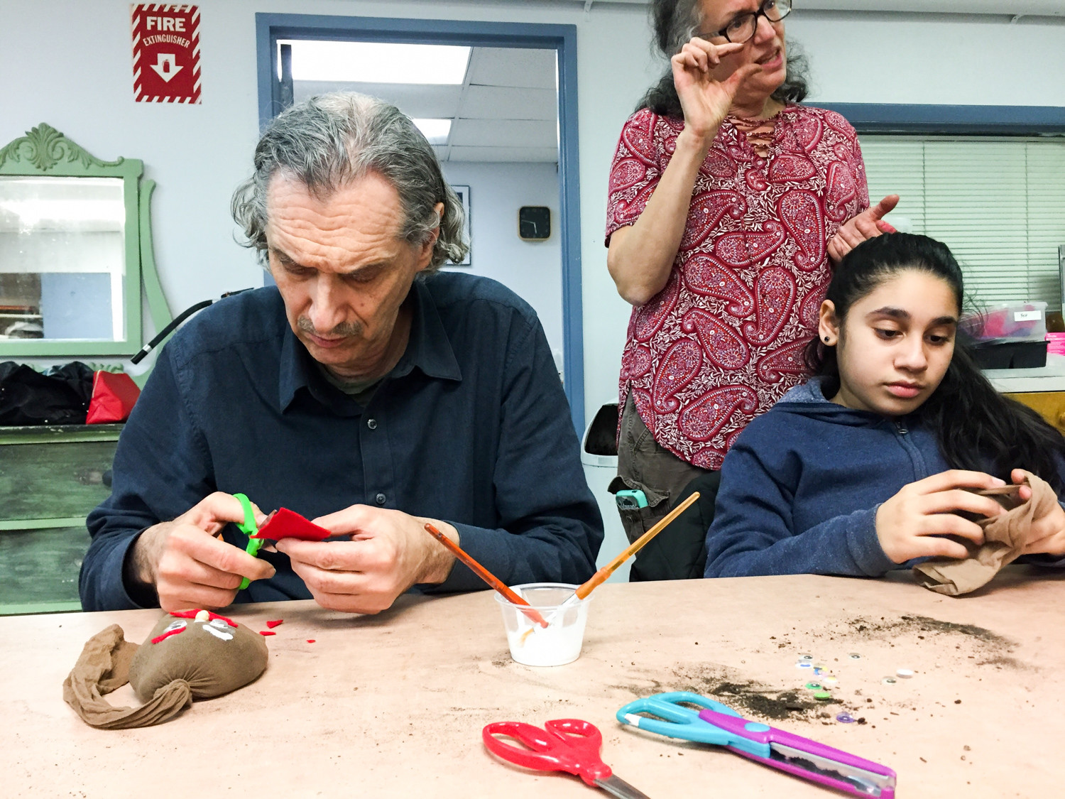 Robert Ackerson and Jillian Ortiz take part in an arts and craft project. The two are part of an inter-generational program between Riverdale Senior Services and Riverdale Community Center, which is looking to bridge the gap between the two generations.