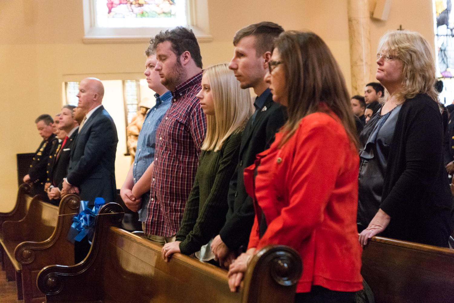 Neil Forster's family stands during the 20th anniversary memorial Mass in the Chapel of the Immaculate Conception at the College of Mount Saint Vincent.