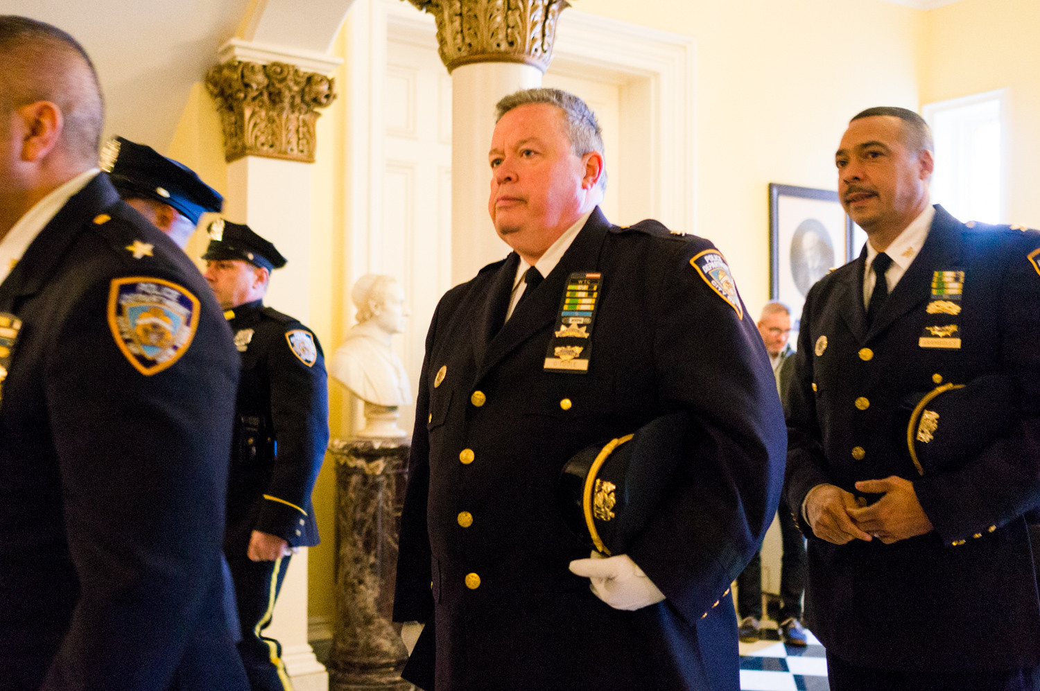 Deputy inspector Terence O'Toole of the 50th Precinct walks into the Chapel of the Immaculate Conception at the College of Mount Saint Vincent for the 20th anniversary memorial Mass for Neil Forster.
