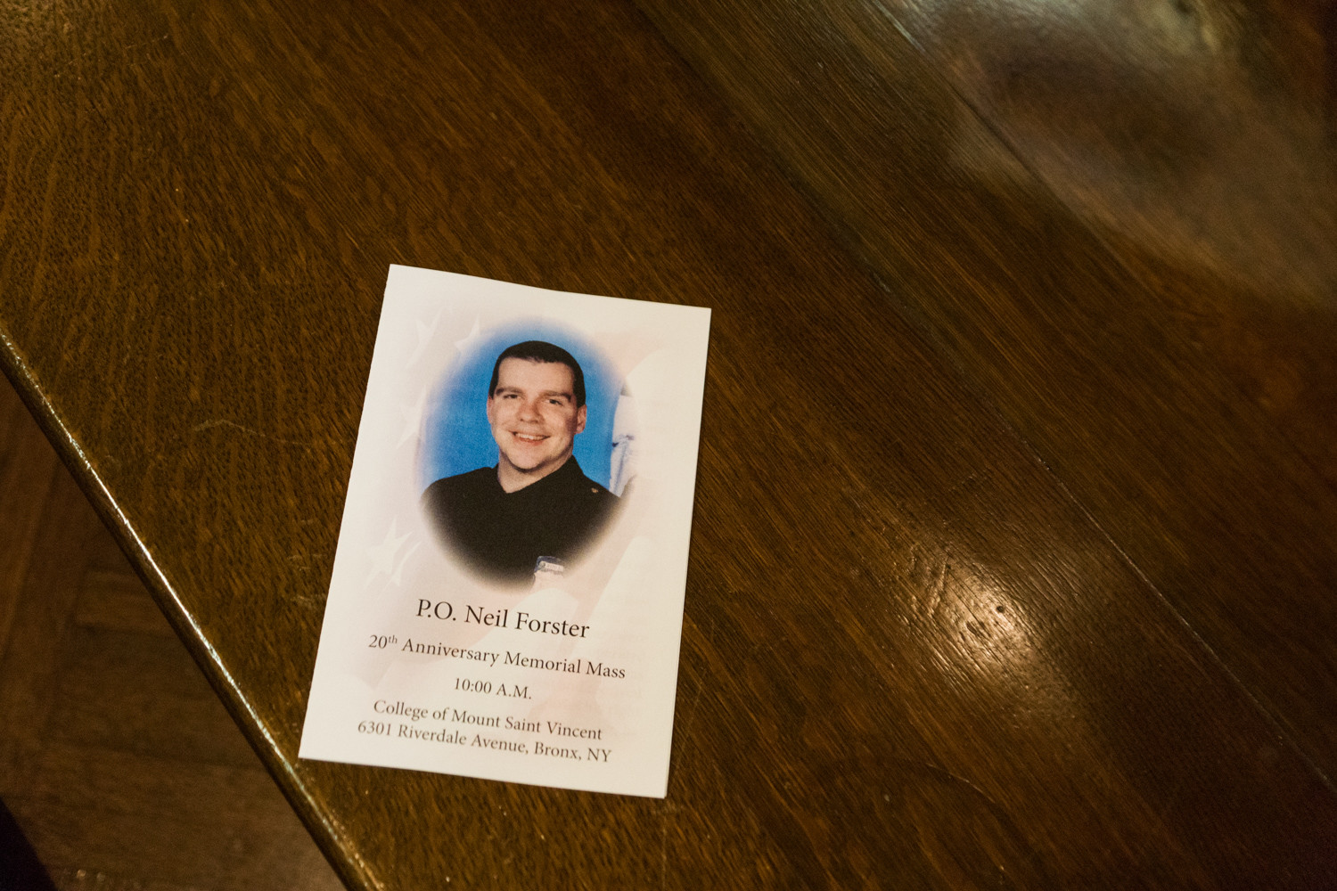 A program for the 20th anniversary memorial Mass for Neil Forster rests on a pew in the Chapel of the Immaculate Conception at the College of Mount Saint Vincent. Forster died of cancer in 1997, a year after sustaining injuries when an alleged drunken-driving off-duty cop hit him.