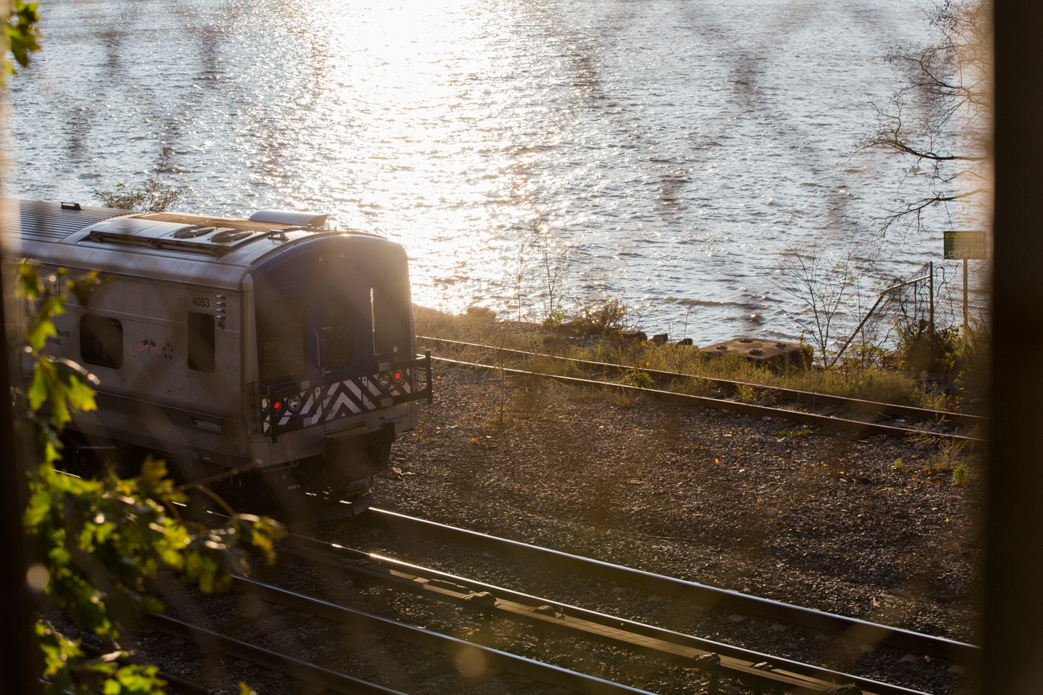 A train traveling along the Hudson River approaches Yonkers as seen from the College of Mount Saint Vincent.