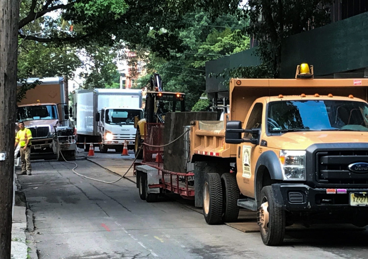 Con Edison's repair trucks take up a wide swath of space on residential streets, and have earned the ire of residents because of unannounced street closures.