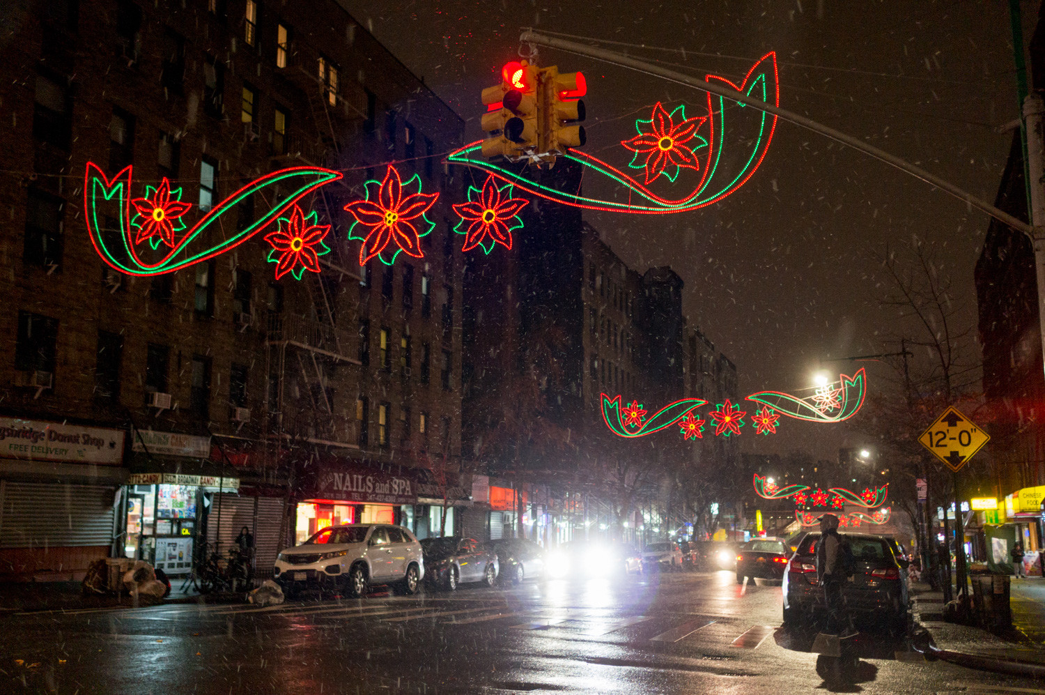 Holiday light displays line West 231st Street, and cast a warm glow after hours.