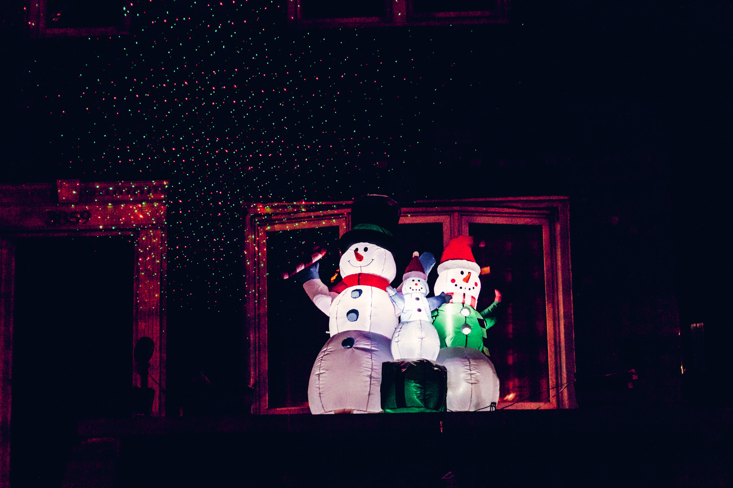 A family of snow people offer season's greetings in the dark of night. Snowmen have been a popular aspect of Christmas for decades, but the first known photograph of a snowman dates back to 1853 by Welsh photographer Mary Dillwyn. The 19th century snowman, however, lacked a corncob pipe and a button nose — or a carrot one, for that matter.