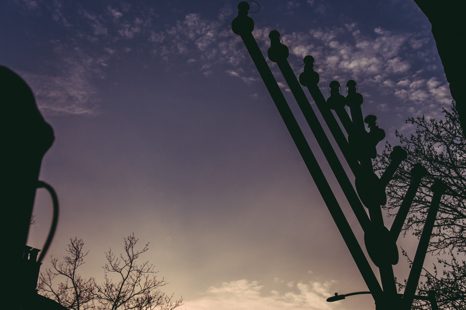 At 23 feet, the menorah at the Riverdale Monument — which stands unlit during sunset on Sunday — is the largest in the Bronx, according to Rabbi Levi Shemtov of Chabad Lubavitch of Riverdale.