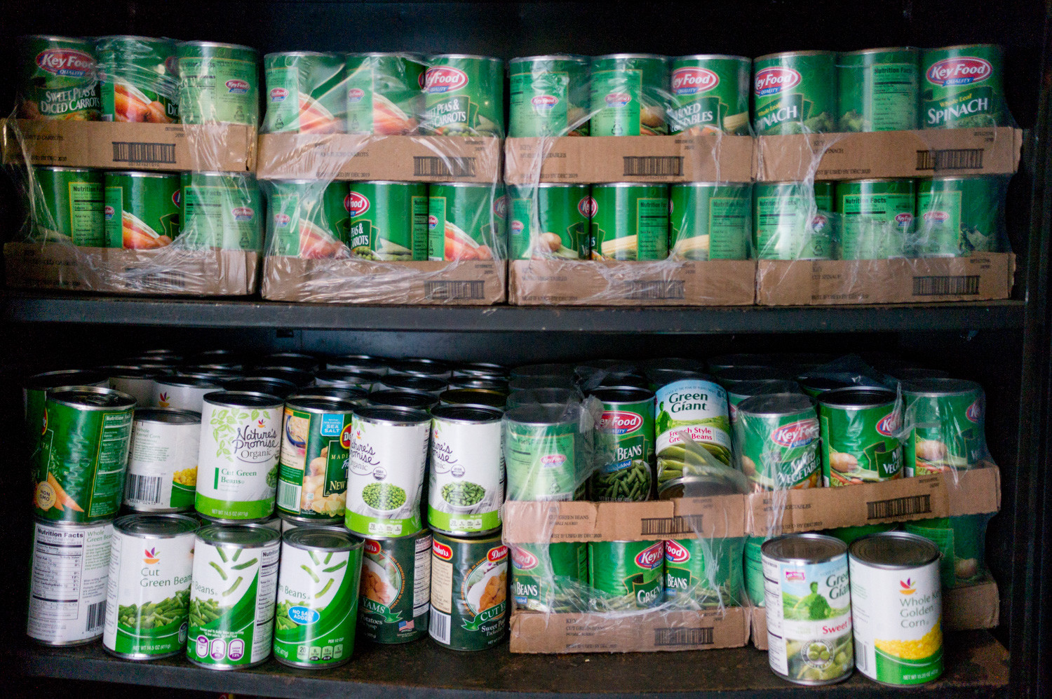 Cans of vegetables rest on a shelf in a shipping container behind the Episcopal Church of the Mediator in Kingsbridge. The Kingsbridge Riverdale Marble Hill Food & Hunger Project runs a weekly food pantry to help local residents who are on food stamps.