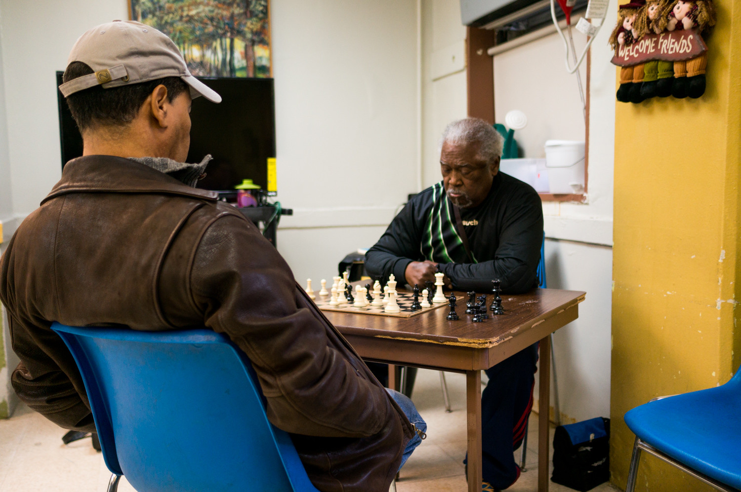 Senior citizens play chess before lunch at the senior citizen center in Marble Hill. Many of the center's participants live in the Marble Hill housing development.