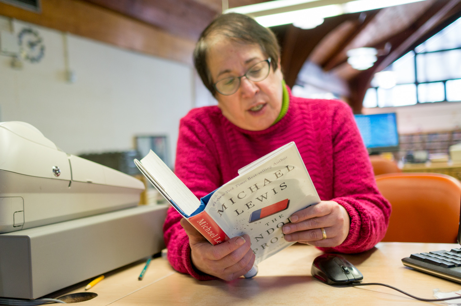 Helene Samberg, a librarian at the Riverdale branch, is one of the many who plans to read 'The Undoing Project,' Riverdale's most checked out book in 2017.