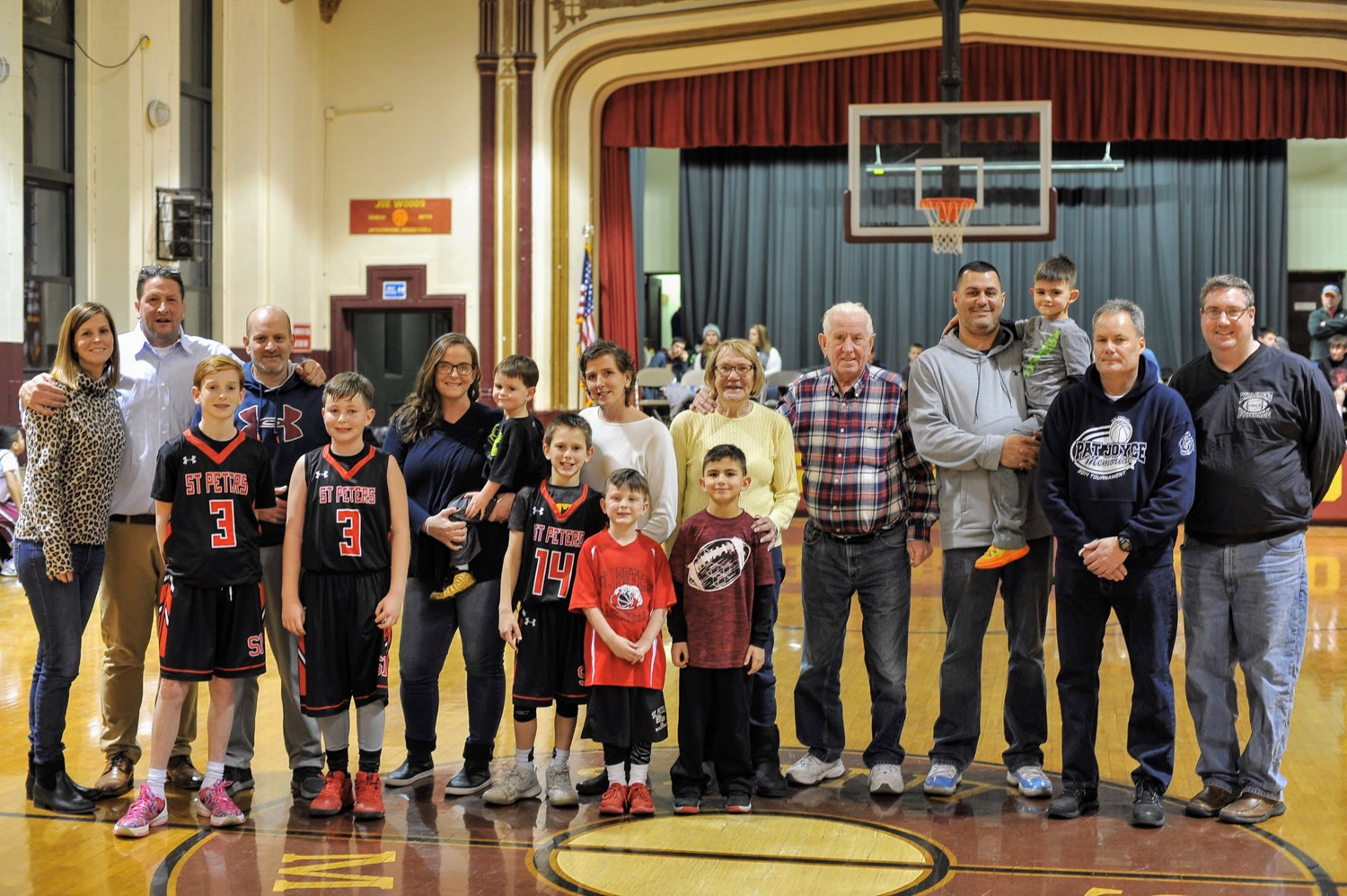 Tournament director Billy McLoughlin, first from right, and Pat Woods, second from right, join members of the Joyce family at the Eighth Annual Pat Joyce Memorial Basketball Tournament at St. Margaret's last week.