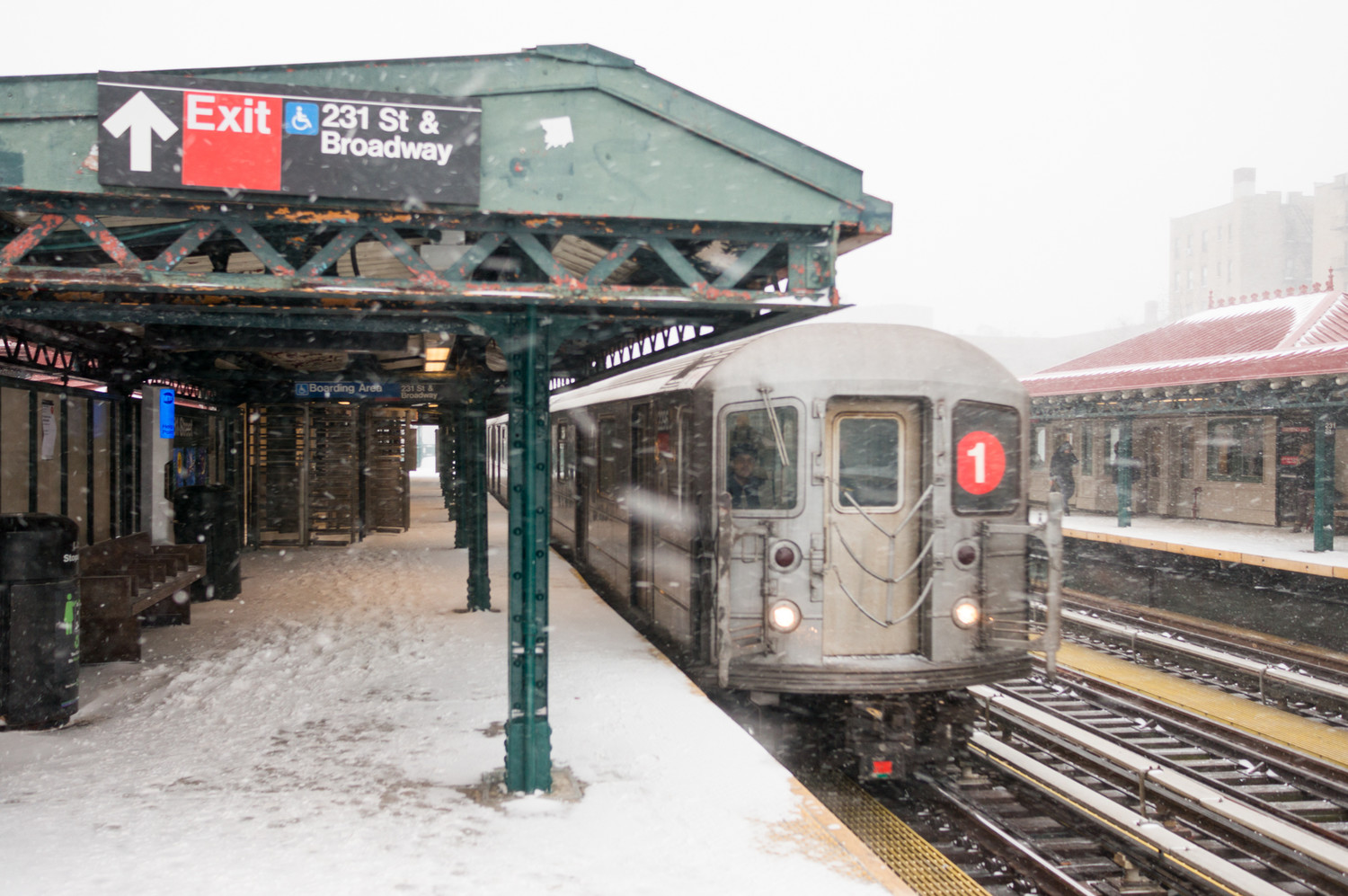 A 1 train pulls into the station at 231st Street during winter storm Grayson.