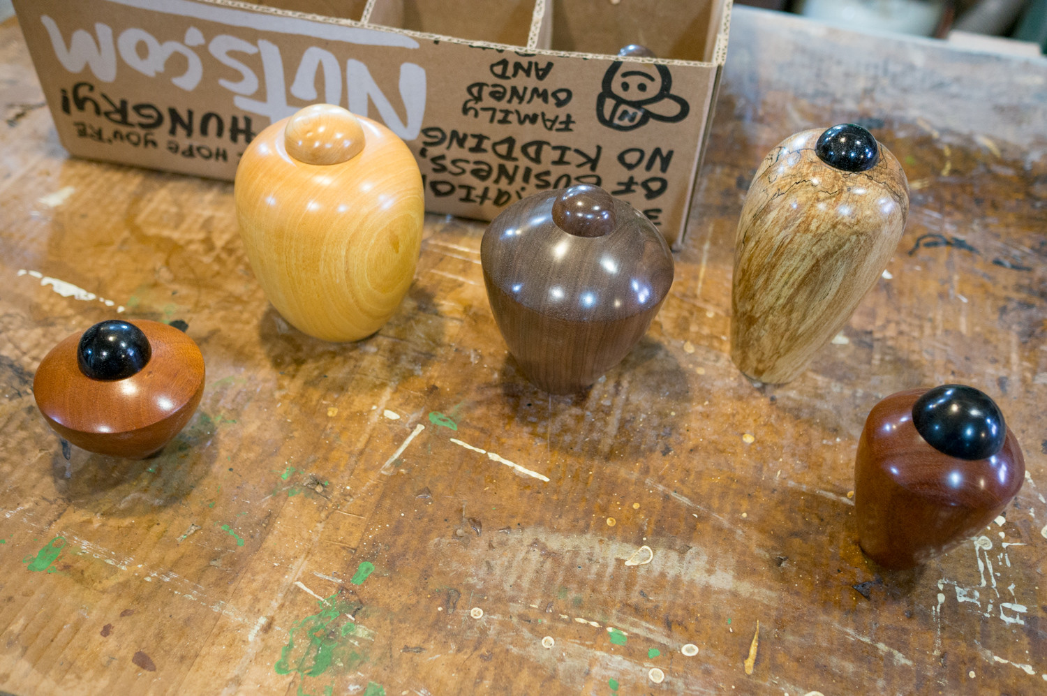 A variety of urns designed for cats rest on Ivan Braun's workbench. Braun is a professional woodturner who typically makes bowls and vases, among other things. He also makes urns for cats.