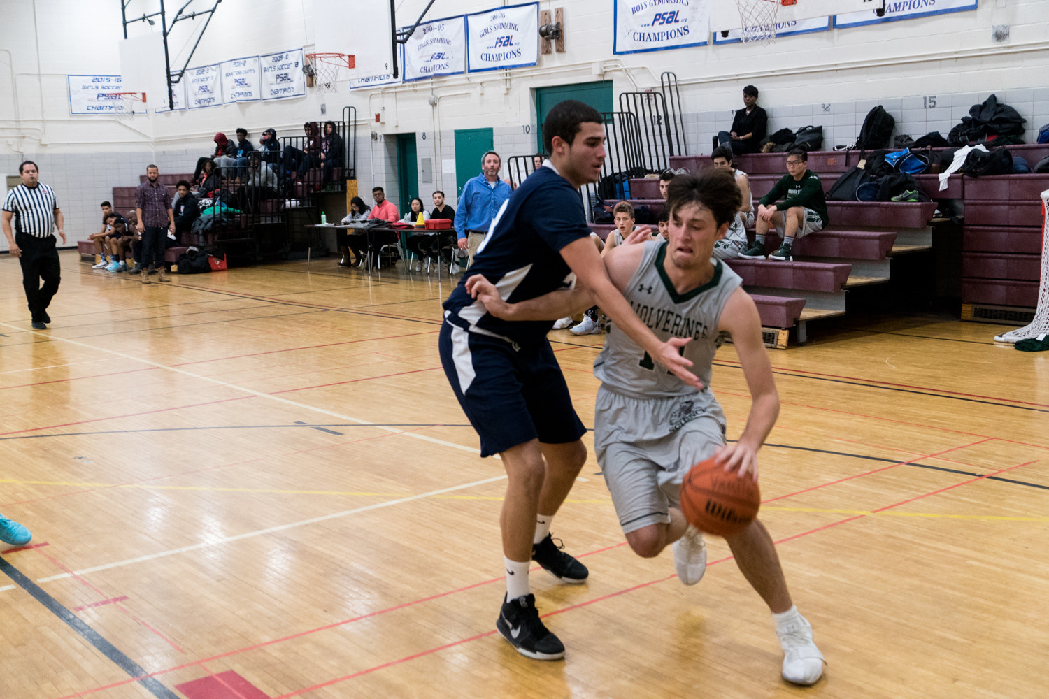 Bronx Science forward Teddy Lowen works his way around a Walton defender during the Wolverines' victory over division-rival Walton.