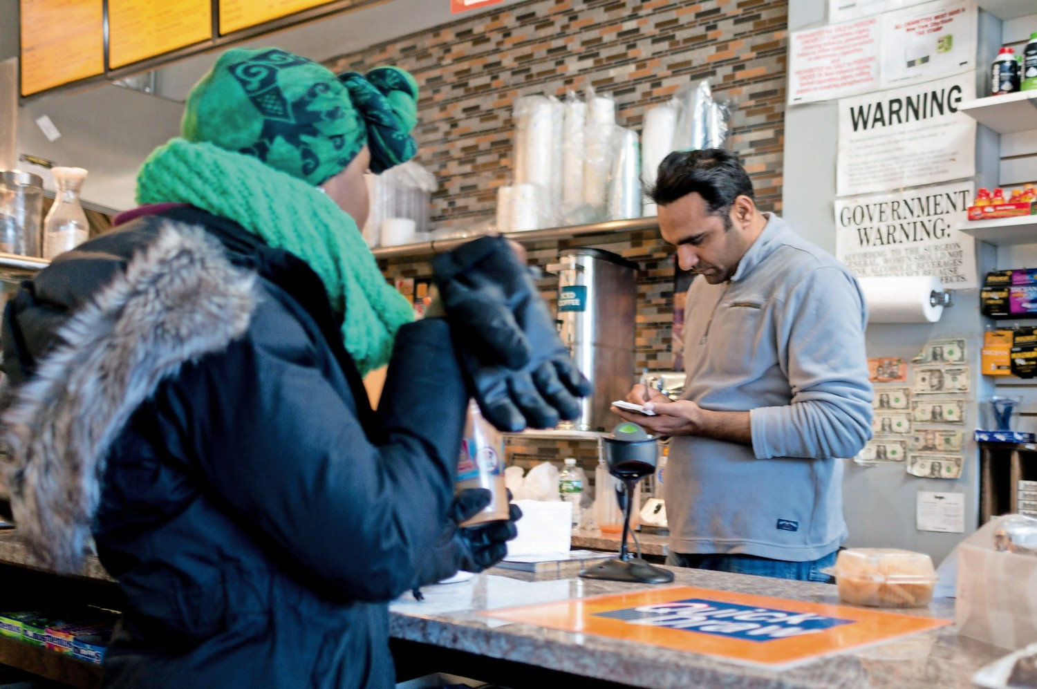 Shahid Shamraz takes an order in Sky View Cafe and Delicatessen.