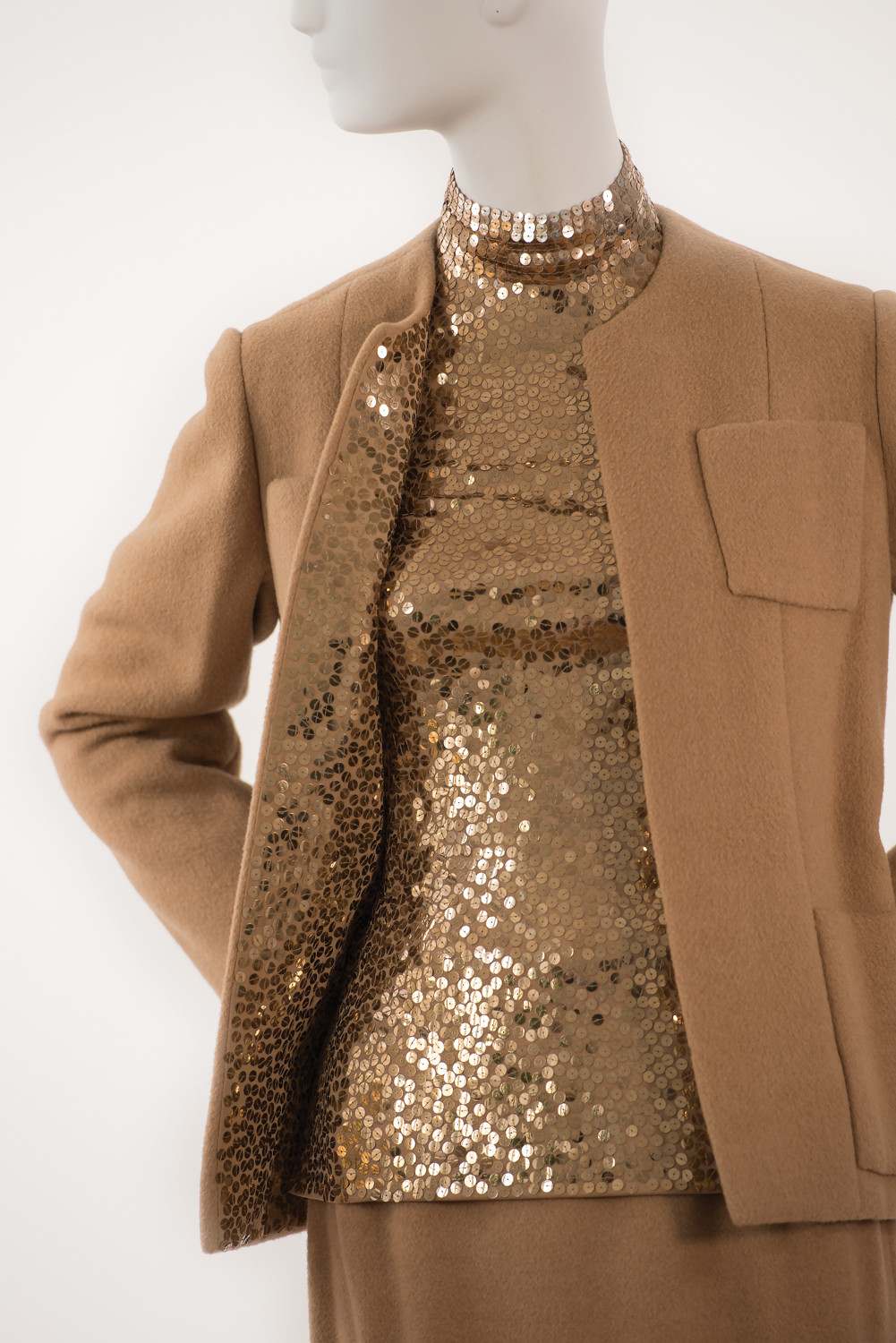 This 1971 camel hair and paillette theater suit is one of nearly 100 items featured at The Museum at Fashion Institute of Technology's exhibition on fashion designer Norman Norell. Some of his clients included former first ladies Jacqueline Kennedy Onassis and Lady Bird Johnson. Michelle Obama wore a vintage dress by Norell during her time in the White House.