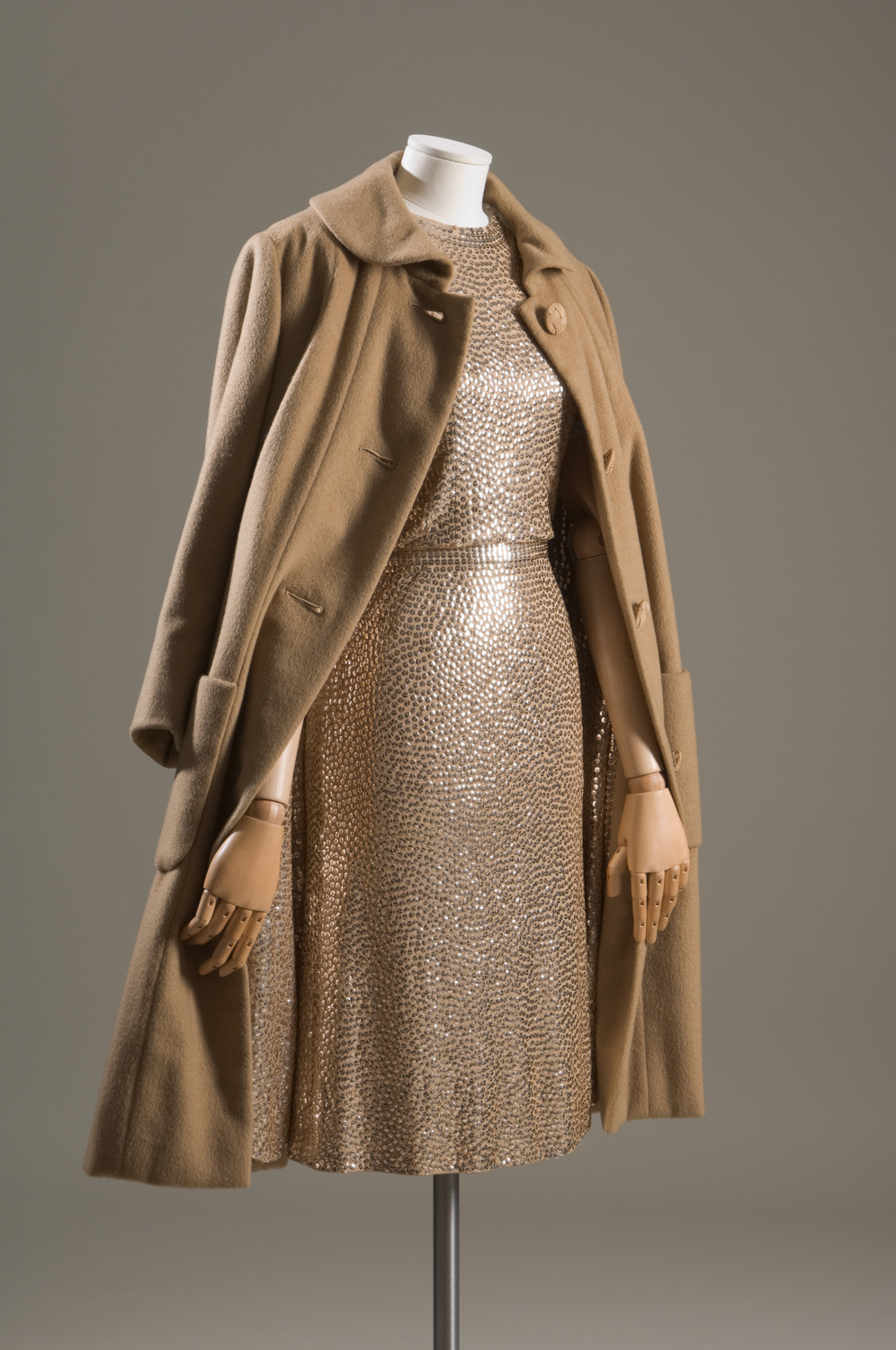 Actress Lauren Bacall once donated a 1950s gold evening coat and dress in cashmere, silk jersey and sequins to The Museum at Fashion Institute of Technology. The Traina-Norell outfit is part of an exhibition showcasing the work of designer Norman Norell.