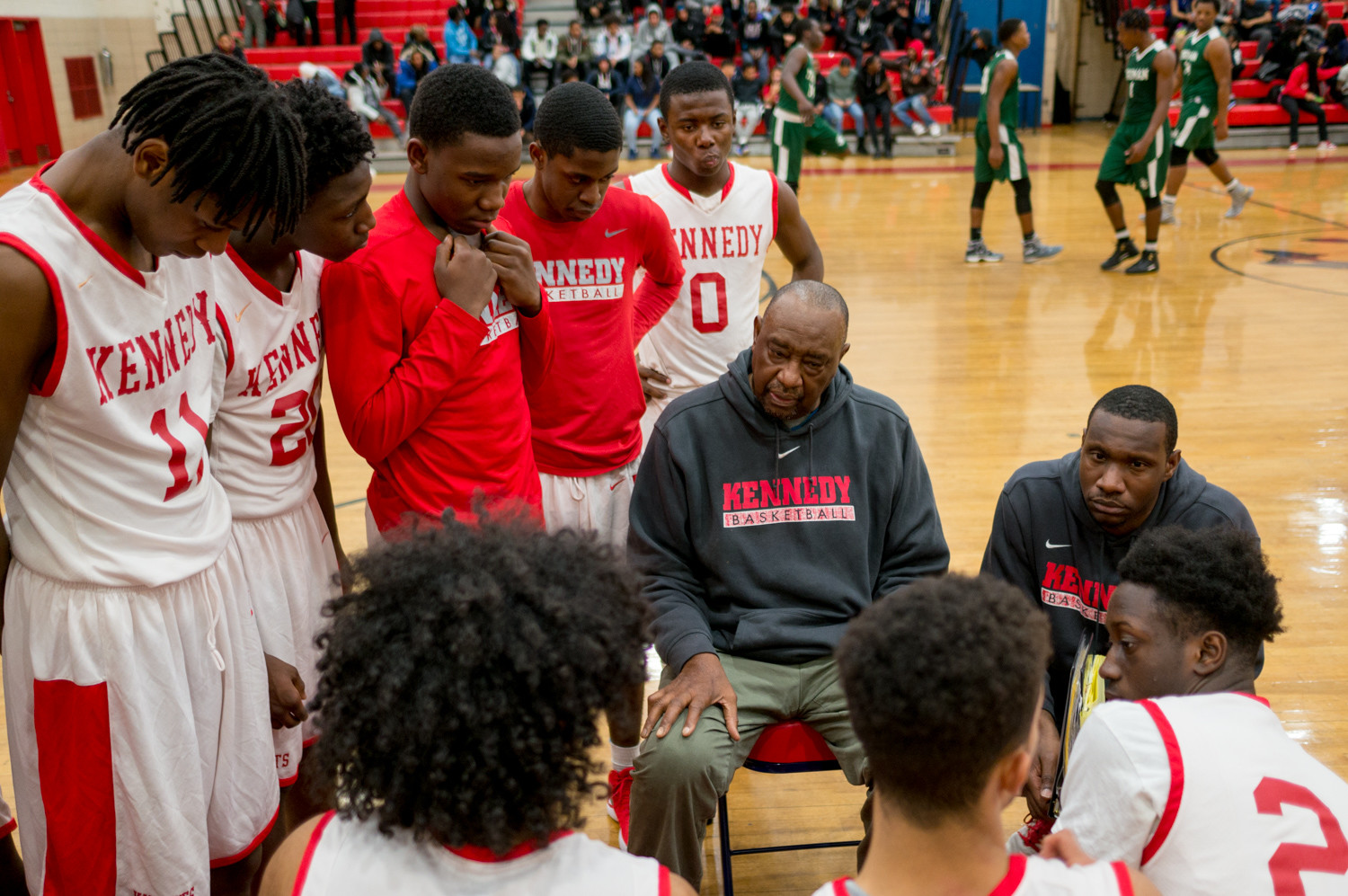 Kennedy head coach Johnny Mathis talks strategy with his Knights during last week's game against Truman.