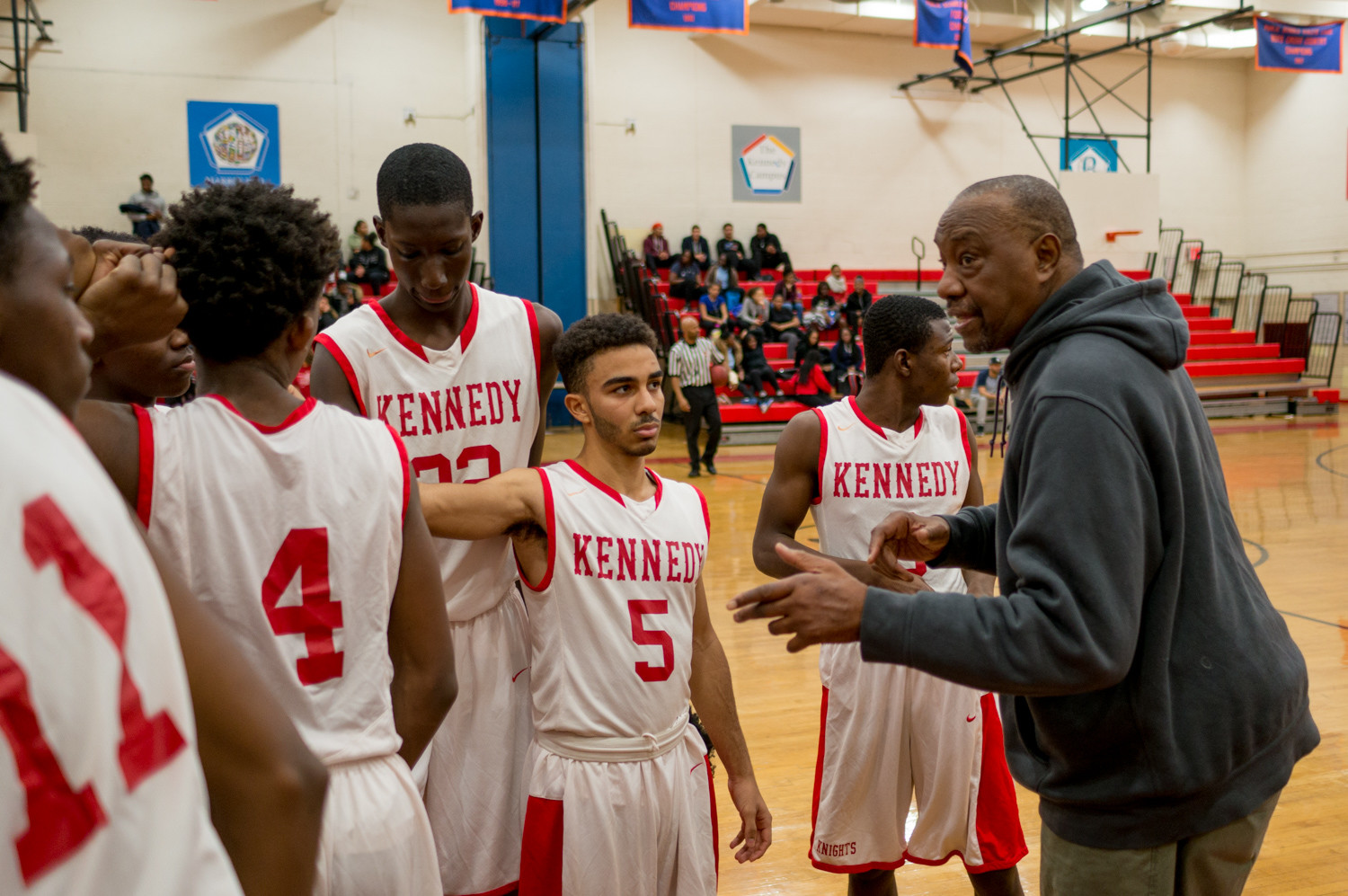 Kennedy head coach Johnny Mathis dishes some pearls of wisdom to Isaiah Malave and the rest of the Kennedy Knights in their game versus Truman.