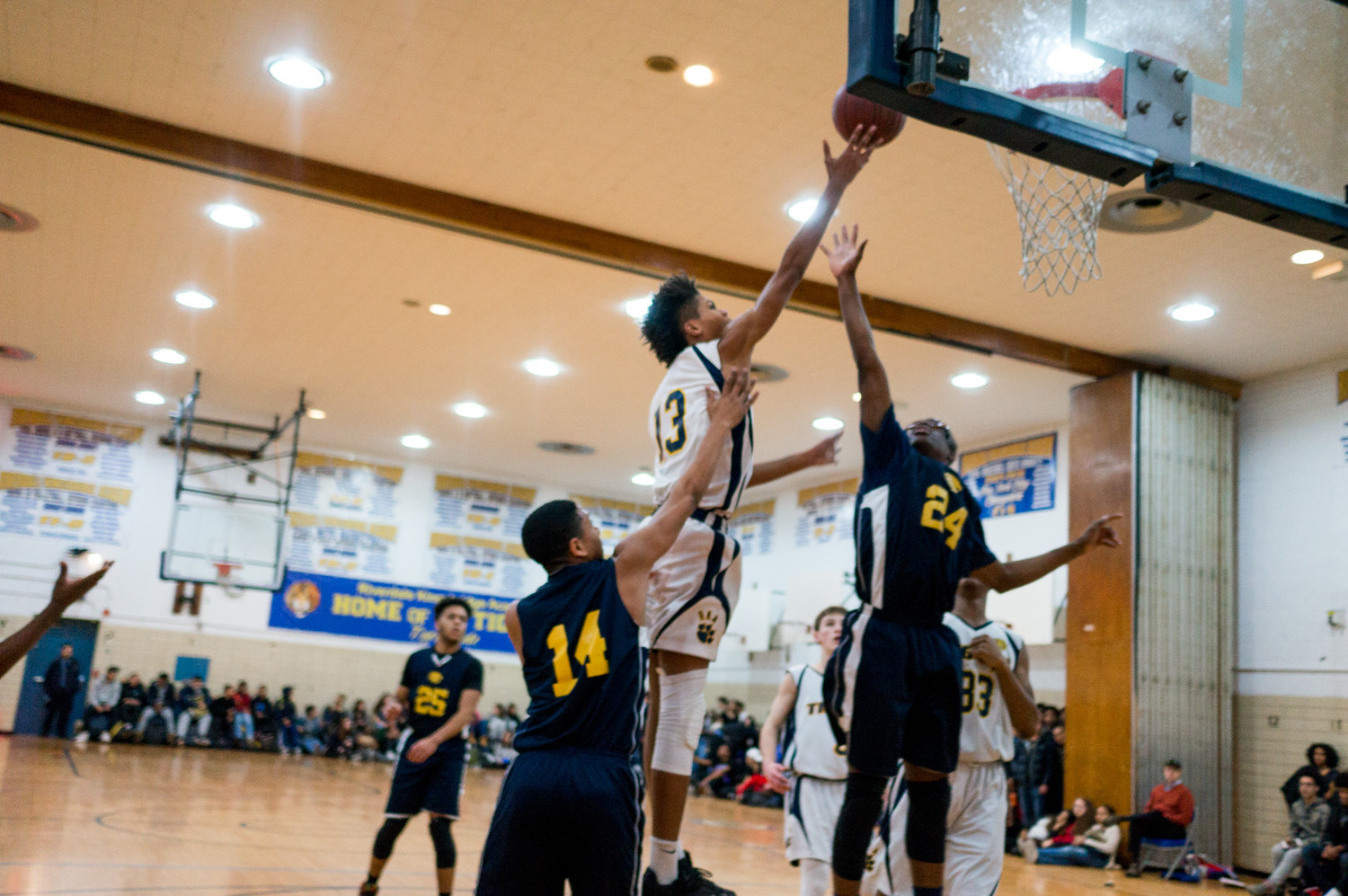 Kai Parris, who logged 20 points, goes up strong over a pair of Hyde Charter defenders in RKA's victory last week.