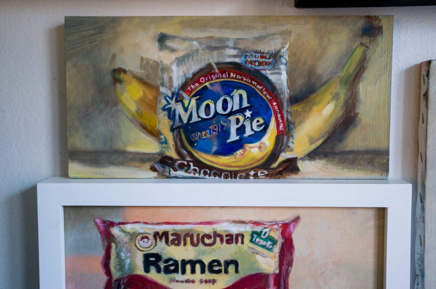 The paintings in Noelle Knight's exhibition 'Food Values' pair healthy foods with unhealthy ones. The exhibition is on view at The Riverdale Y until Jan. 31.