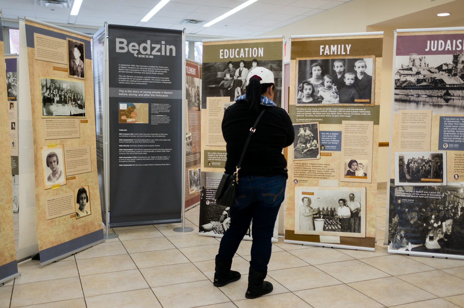 A woman looks at the exhibition 'Through the Eyes of Youth: Life and Death in the Bedzin Ghetto,' which is on display at the Hebrew Institute of Riverdale until Jan. 26.