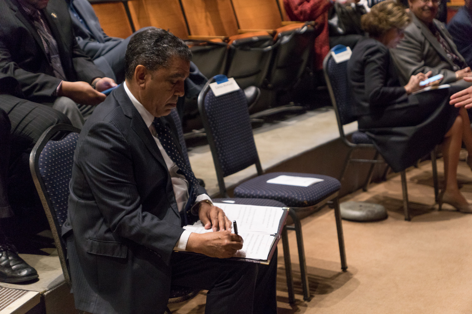 U.S. Rep. Adriano Espaillat goes over his speech before taking the stage at Lehman College last year. Espaillat headlines a free meet-and-greet breakfast hosted by the Van Cortlandt Jewish Center on Jan. 28, with other elected officials expected to attend.