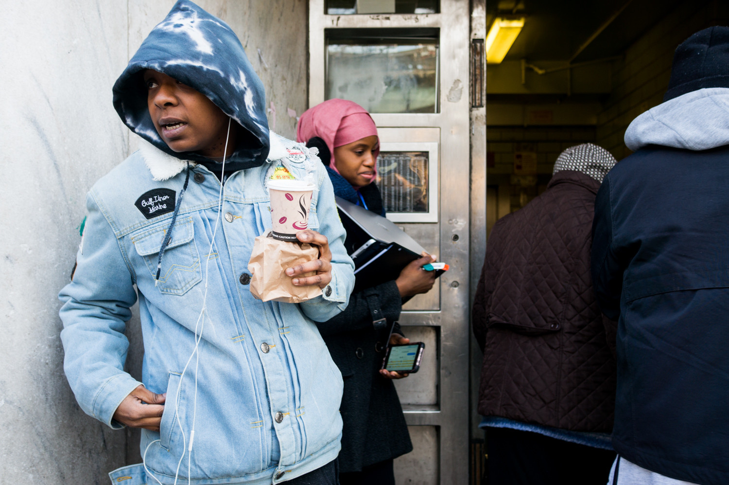 Sieta Montford, a resident of the New York City Housing Authority's Marble Hill development, left, talks about problems in her building. One major issue — the front door lock is broken, allowing anyone to enter.