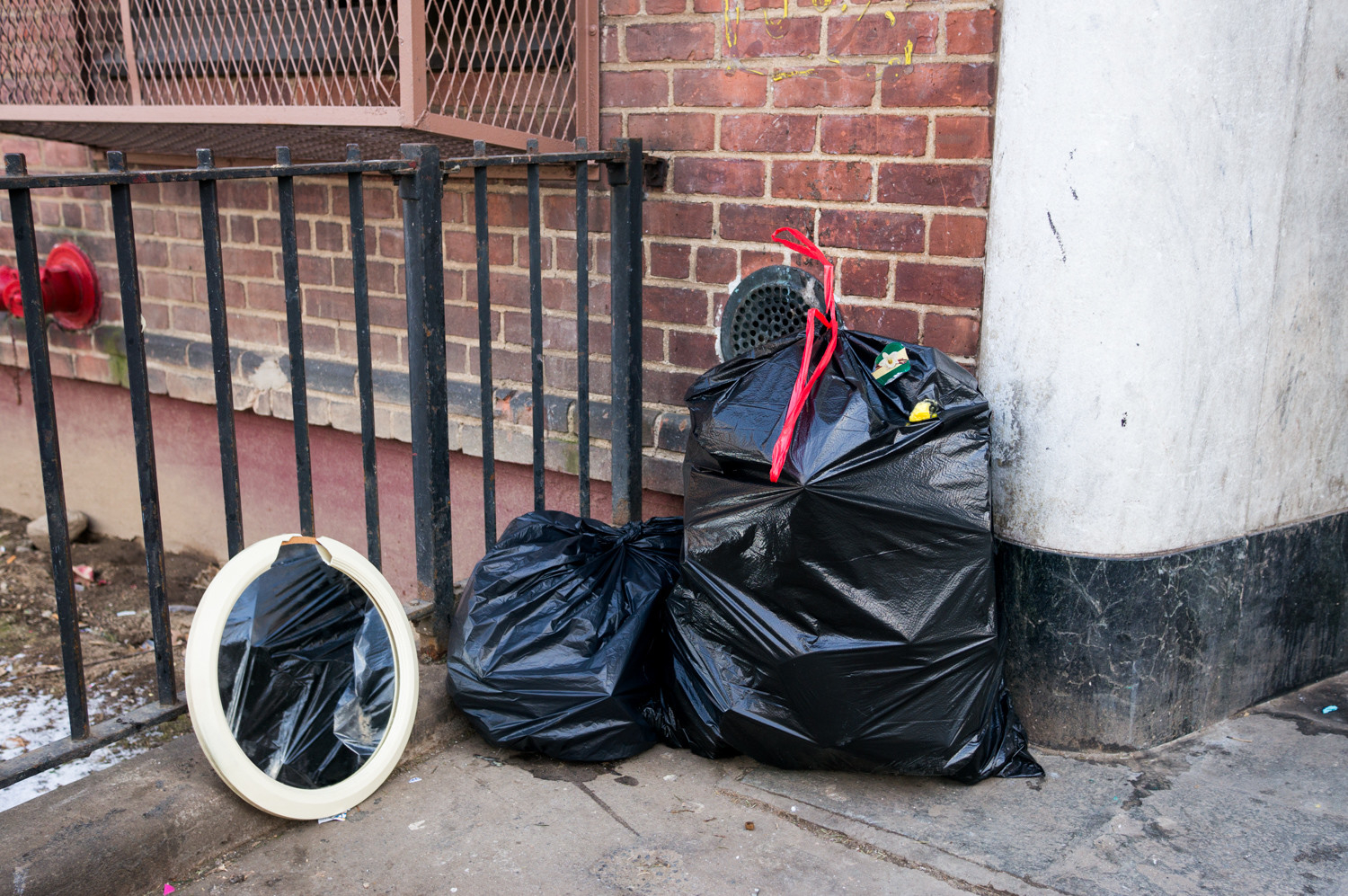 Some residents of the New York City Housing Authority's Marble Hill development complain about garbage being left in front of the buildings.